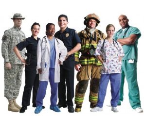 A group of emergency personnel in their different uniforms. From left to right: National Guard, Police Officer, Doctor, Paramedic, Firefighter, Nurse, and Surgeon.