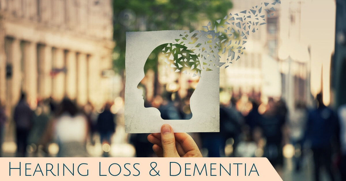 Hart Hearing located in Rochester, NY helps to serve those with hearing loss. Hearing Loss and Dementia. Someone holding a paper cutout of a person's head with snips of paper drifting out of the back of the head and away.