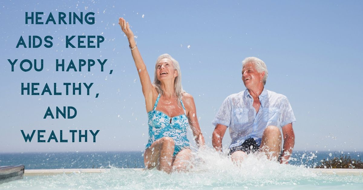 Hart Hearing - Hearing Aids Keep You Happy, Healthy, and Wealthy. An old couple sitting on the side of a pool splashing in the water.