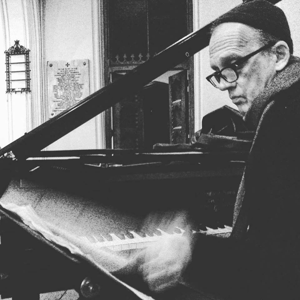Denis at Piano St Lukes blurry hand.jpg