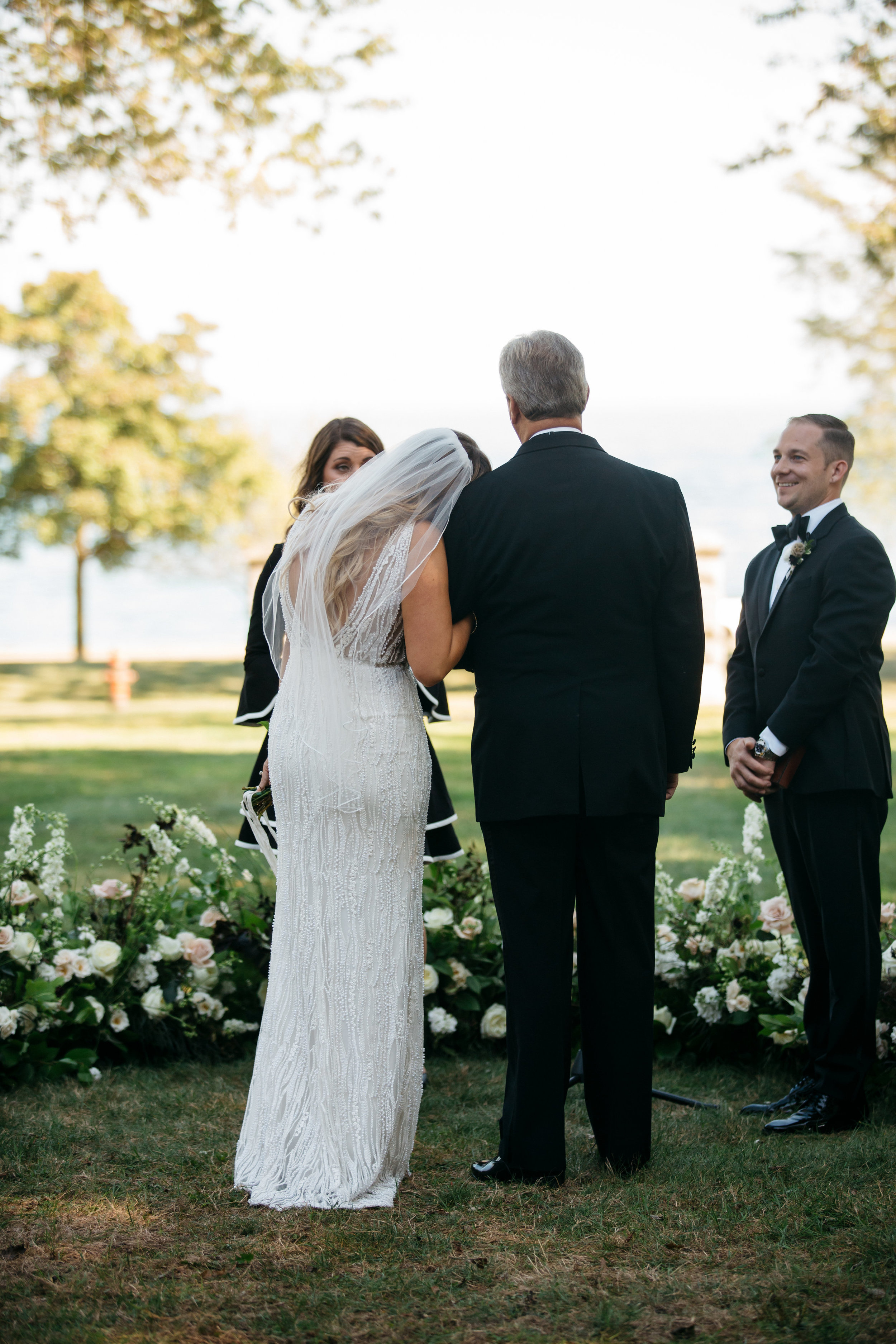 detroit michigan high end wedding planners florals dress outdoor ceremony waterfront