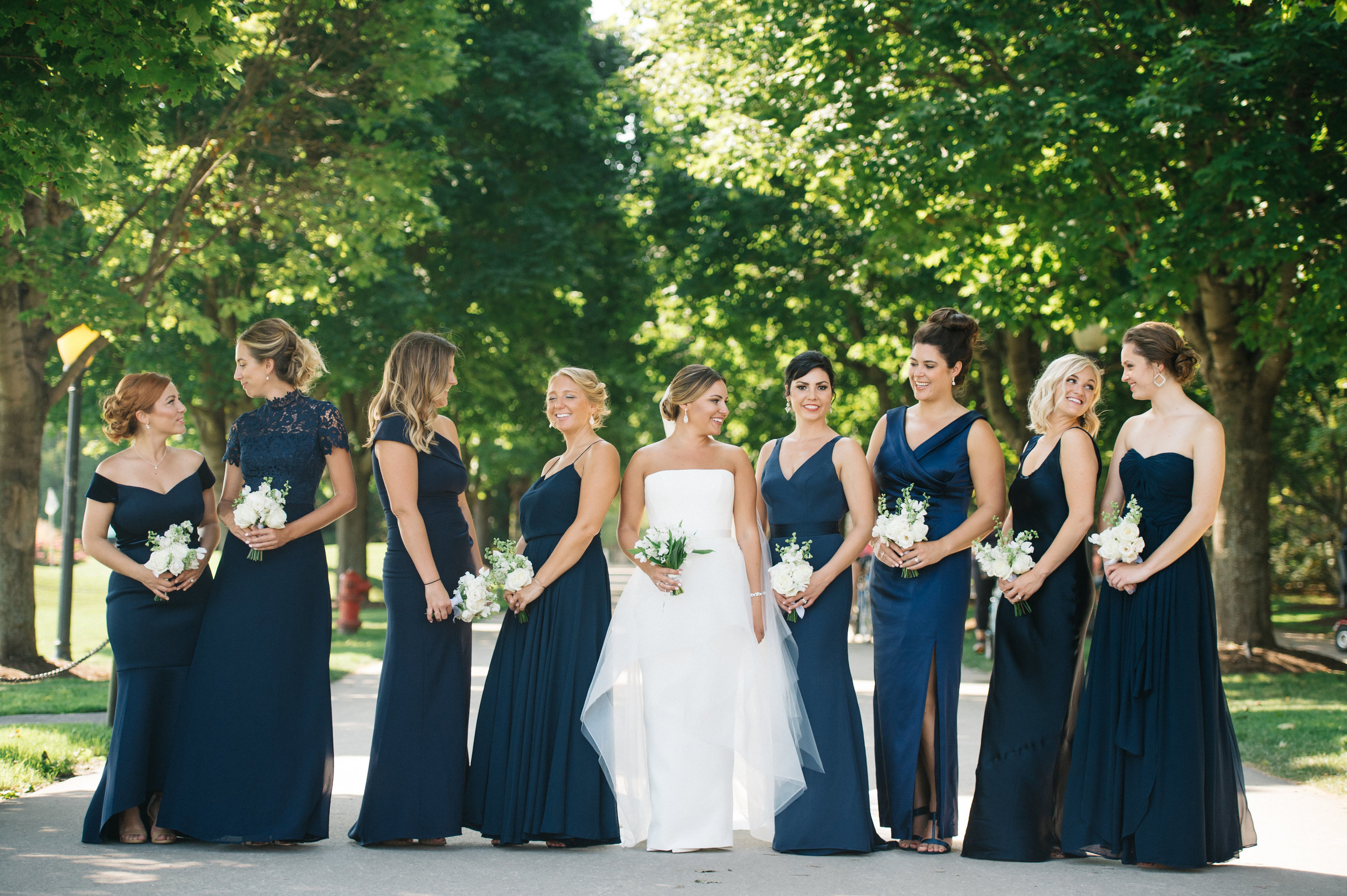 custom wedding planners michigan event design paper goods florals nautical mackinac island sparkler exit bridal party bridesmaids navy