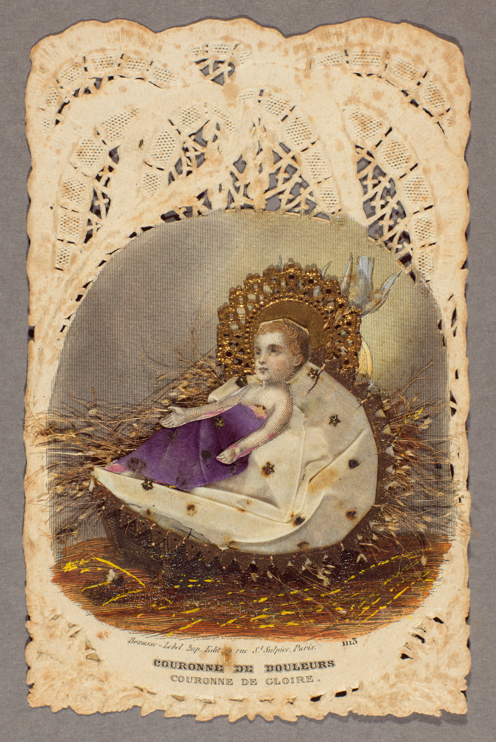 """A devotional card made in Paris in the mid-1800s that reads, """"Crown of sorrows, crown of glory."""" The image is engraved on lace paper, with applied elements including die-cut and gilded scraps, tissue and dried flowers."""