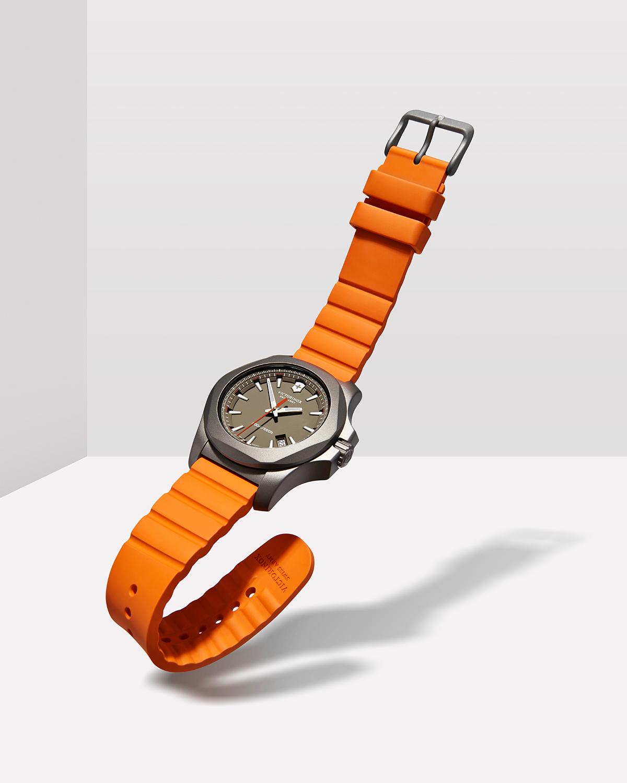 tom-medvedich-still-life-jewelry-watches-victorinox-inox-orange-01.jpg