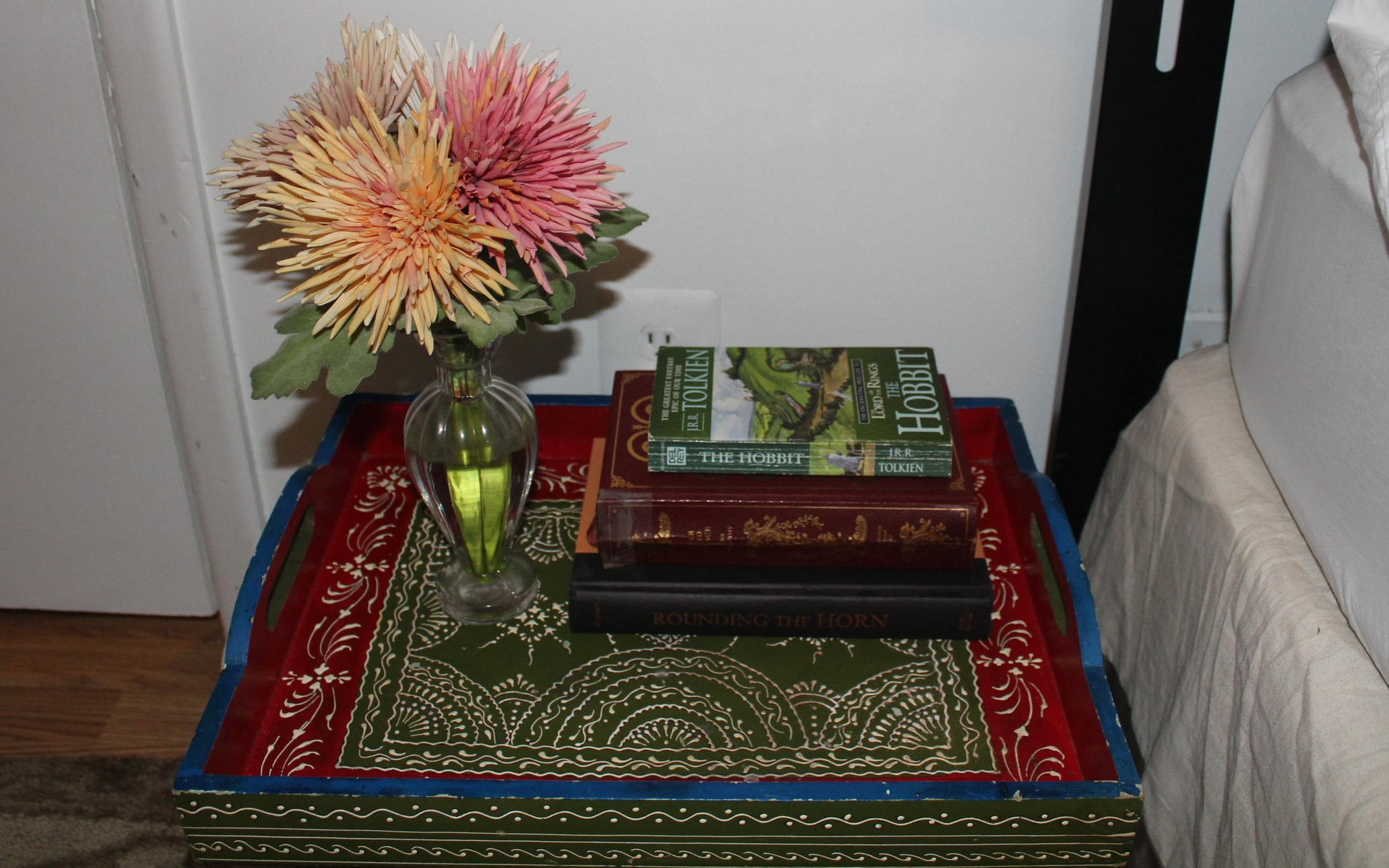 SPRING - Add some bright colored flowers in a pretty vase to your bedside table.