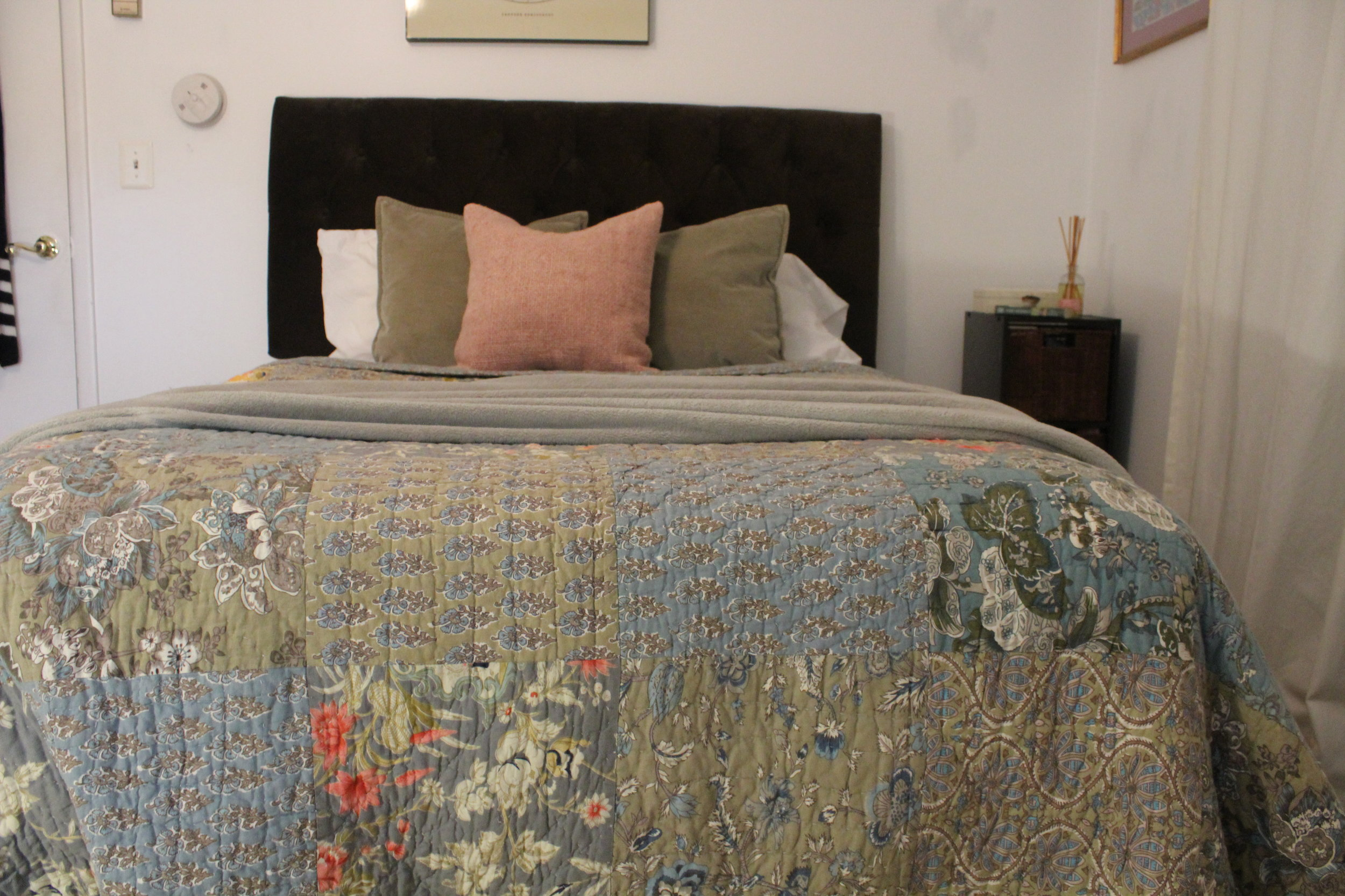 SUMMER - Time to lighten up the layers and keep it simpler with smaller throw pillows.