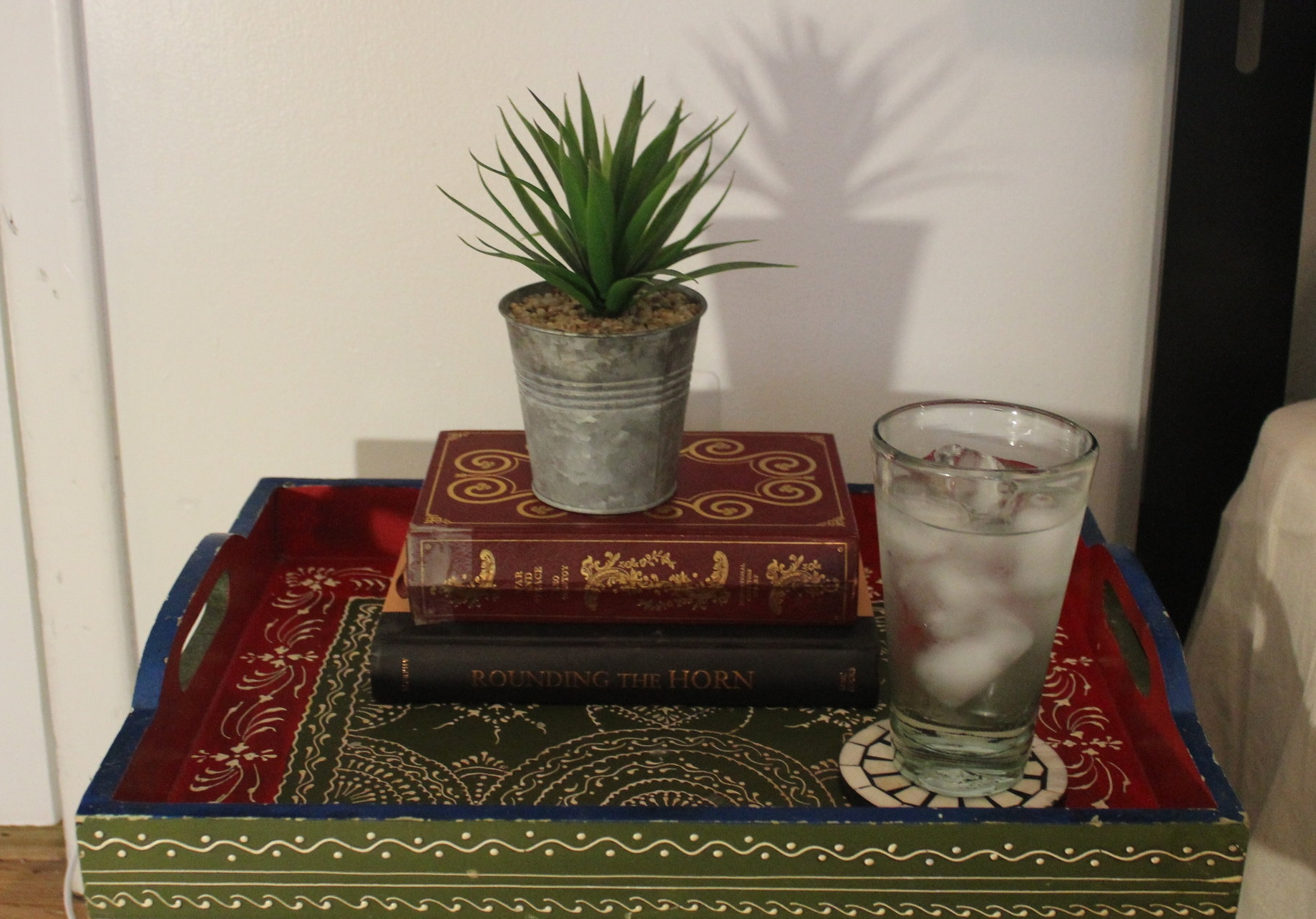 SUMMER - A small succulent on top of a stack of books and a glass of ice water on a bedside table will have you ready for the heat.