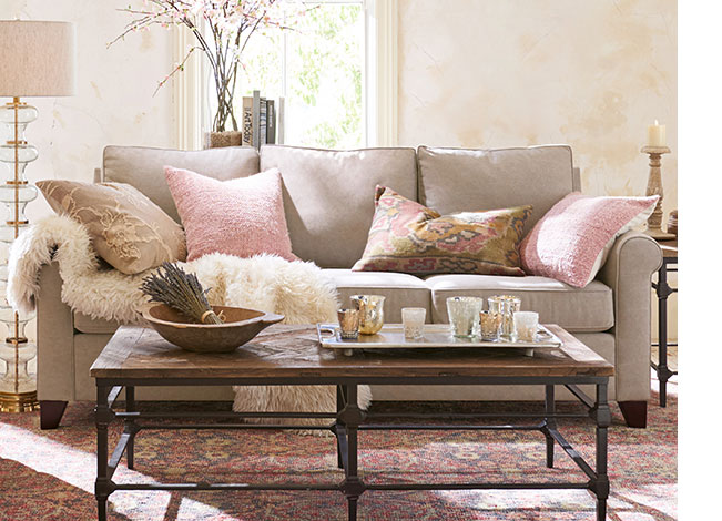 PotteryBarn.com Two of the same pink textured pillows are the base, the tan pillow softens the look with a subtle pattern, the lumbar is the accent with a bold pattern. The throw blanket adds warmth.