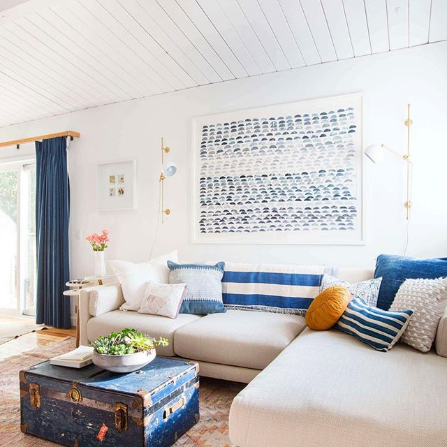 Instagram @em_henderson . This sectional has a playful look with bold colors, mixed patterns, shapes and sizes! The bold blues tie everything together!