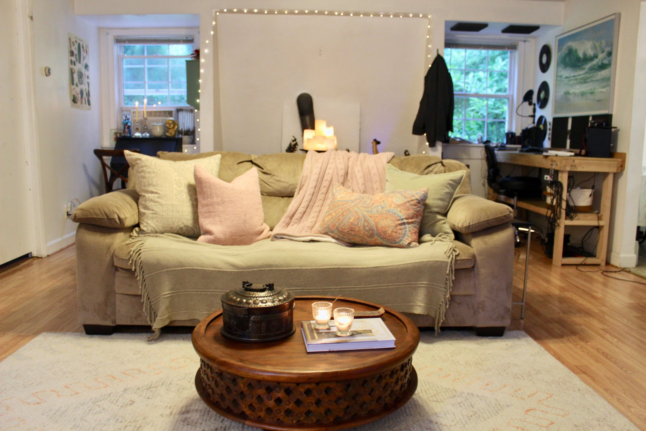 - I was able to switch up my living room look with a few simple changes, and more importantly without spending any money! I used pale pink & green pillows on the sofa for a summer-time vibe, and added in the paisley lumbar pillow to tie in the pillows to the colors in my rug.