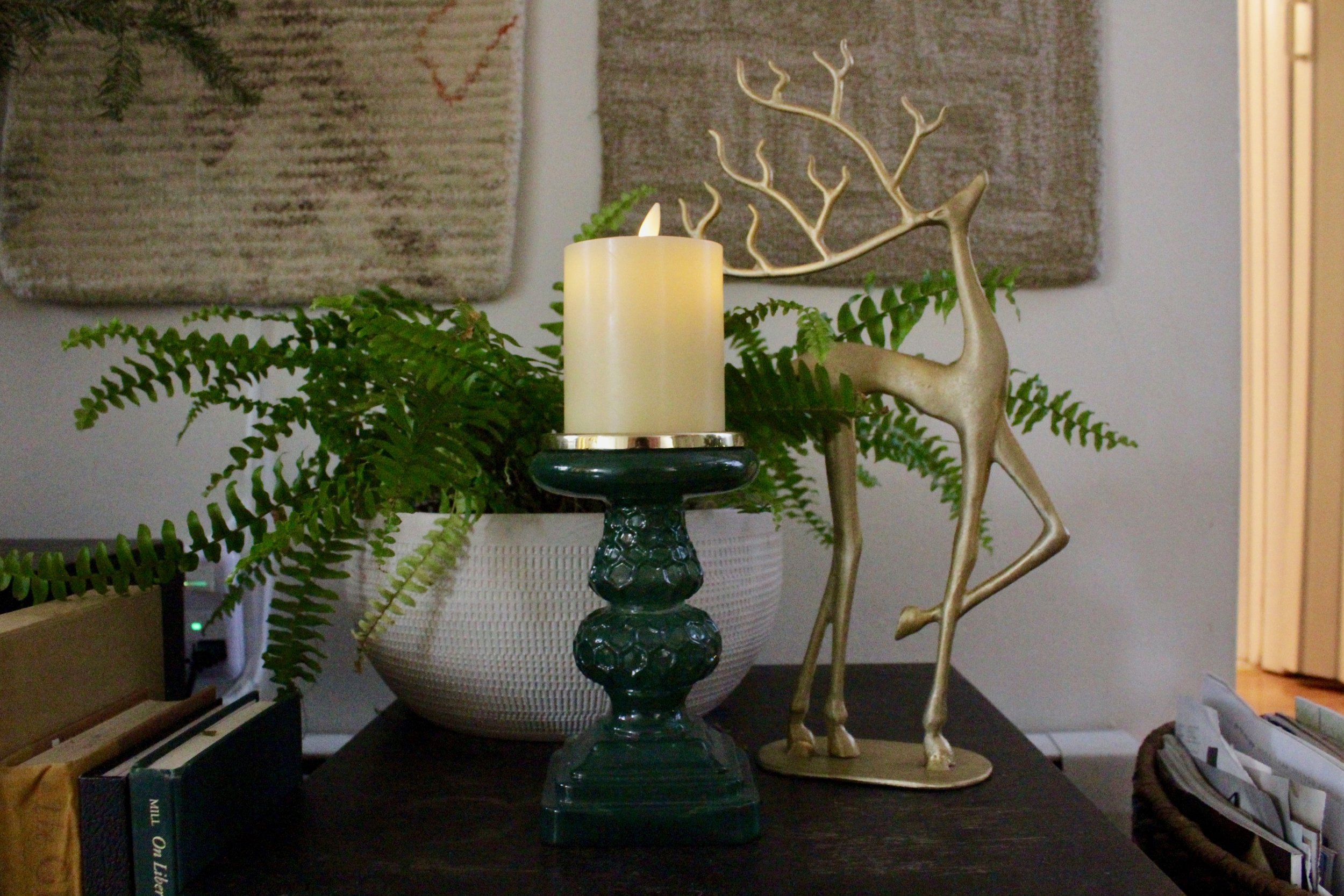 Opal House Candle Holder $14.99 - I have been obsessed with this candle holder since I bought it, comes in other jeweled toned colors but this deep green has my heart! Plus it goes so well with my decor any time of year.Click here to shop