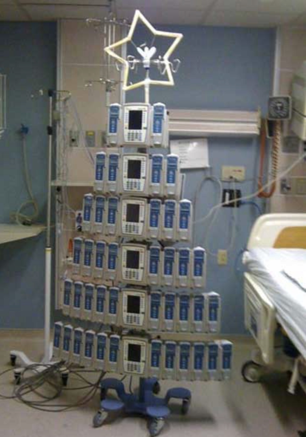 The IV pump Christmas tree - Where did all the pumps go? This one may look familiar as it was circulating a lot last year, but I still love it.