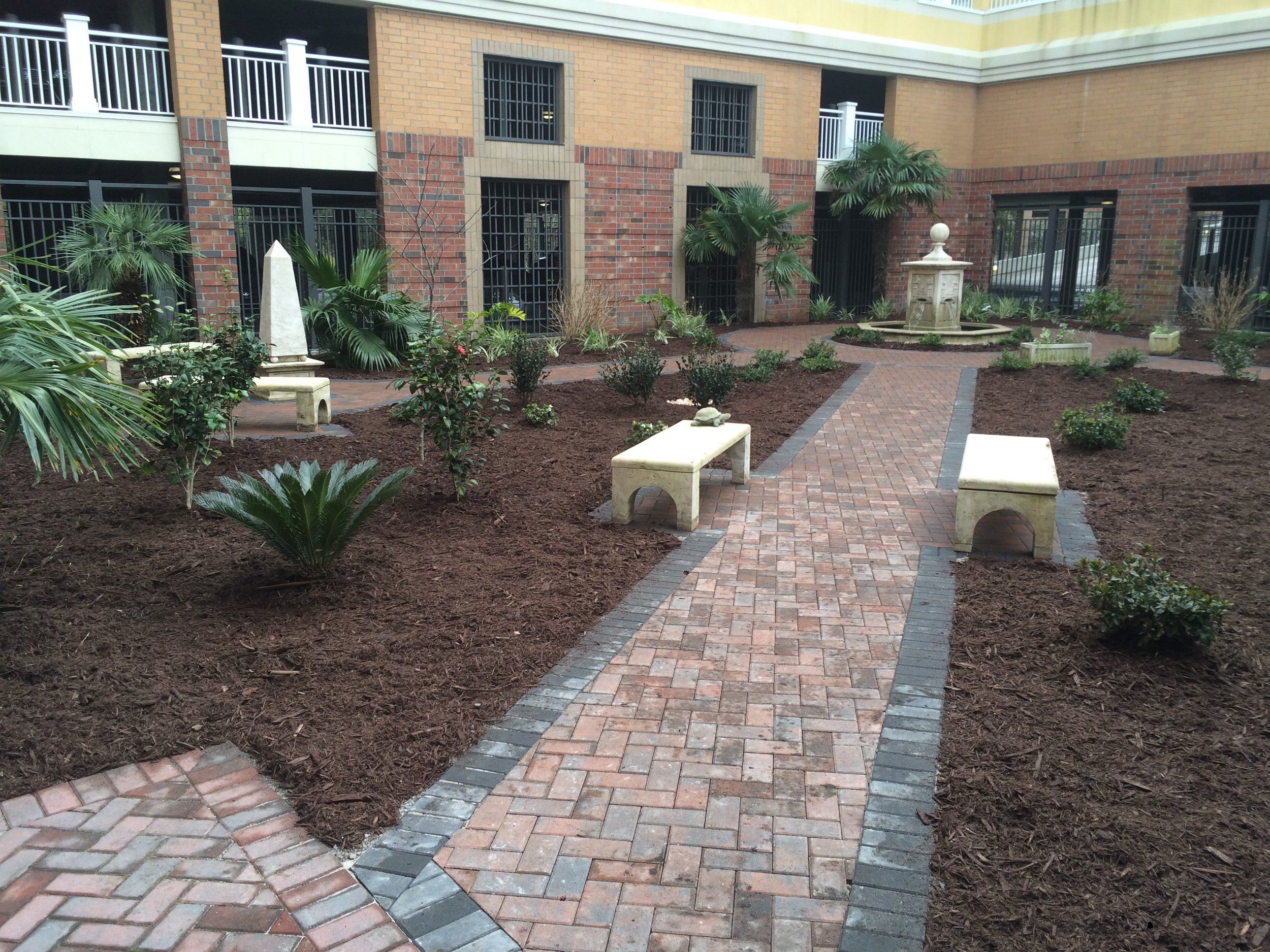 Hardscapes - Paver patios and sidewalksFire pits (wood and gas)Built-in grillsOutdoor kitchensSeating wallsRetaining wallsPlanters