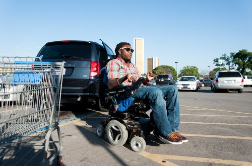 Nnaka runs an errand at a local Wal-Mart before heading home in Tulsa. Before he got his own van, Nnaka had to rely on a special lift service provided by the city to get around. -Kenneth M. Ruggiano for NPR