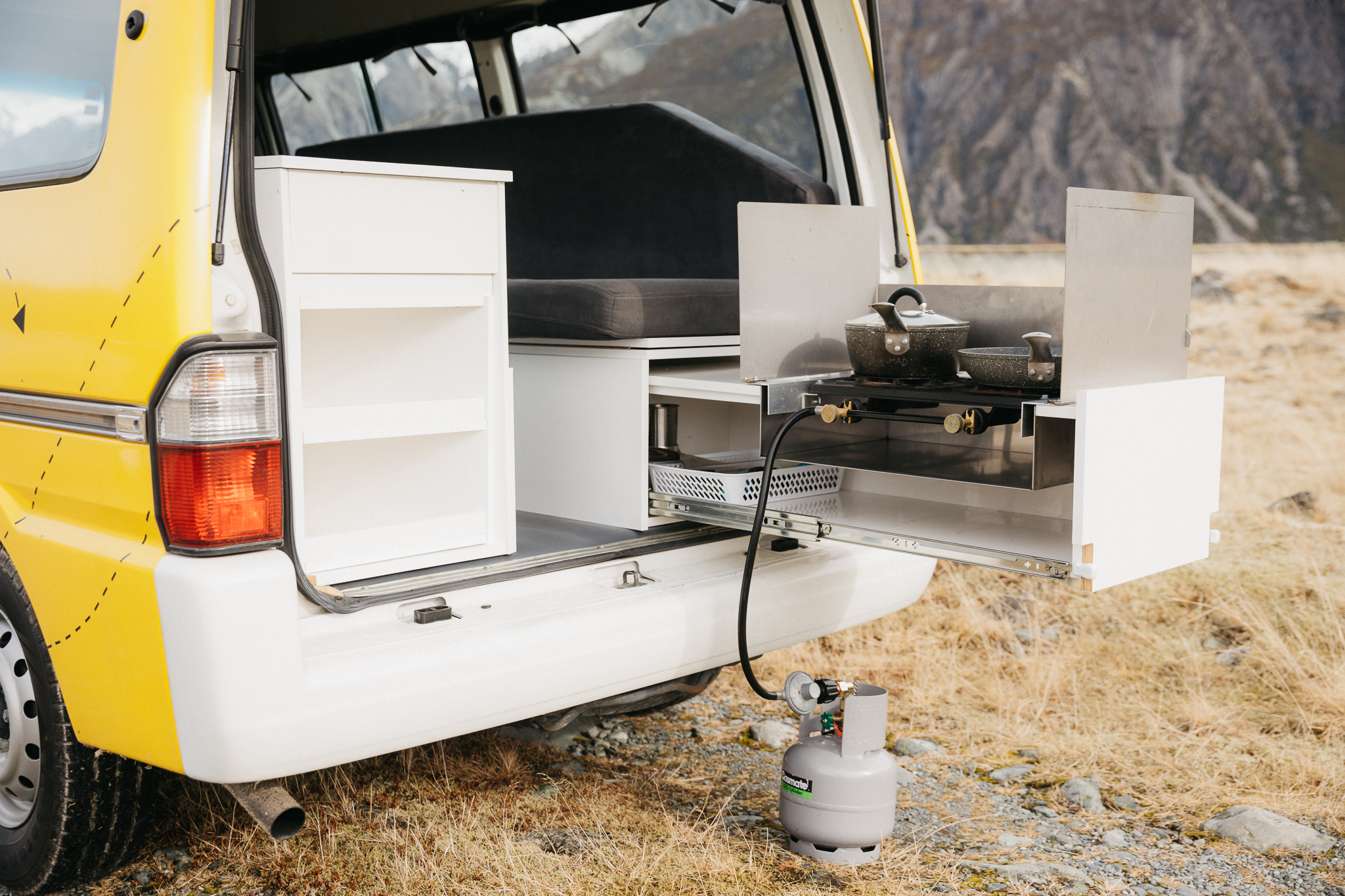 Two-burner cooker and a kitchen with everything you'll need to make a feast on the road!