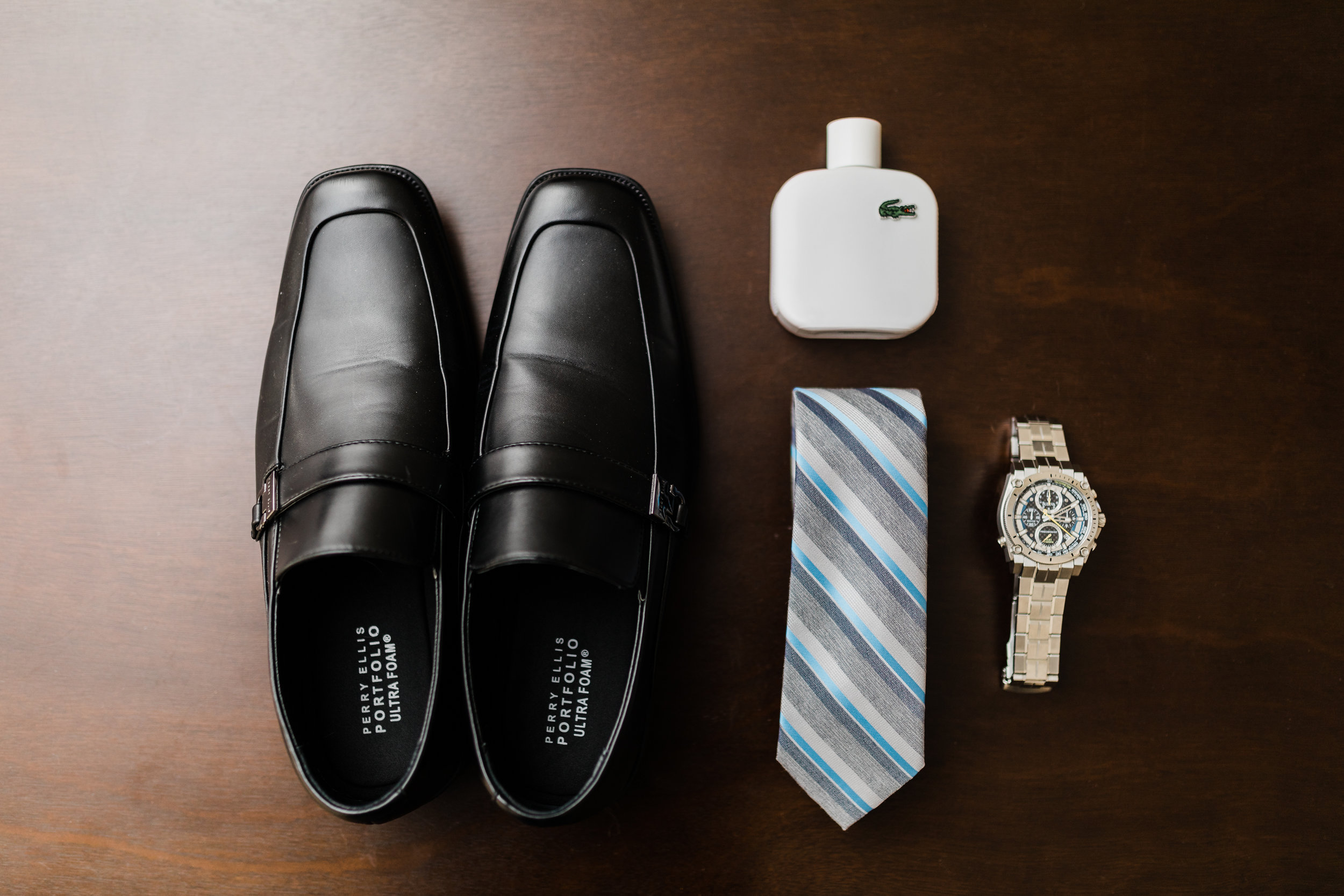 Groom details - watch, cologne, tie, and shoes for Maryland winter wedding
