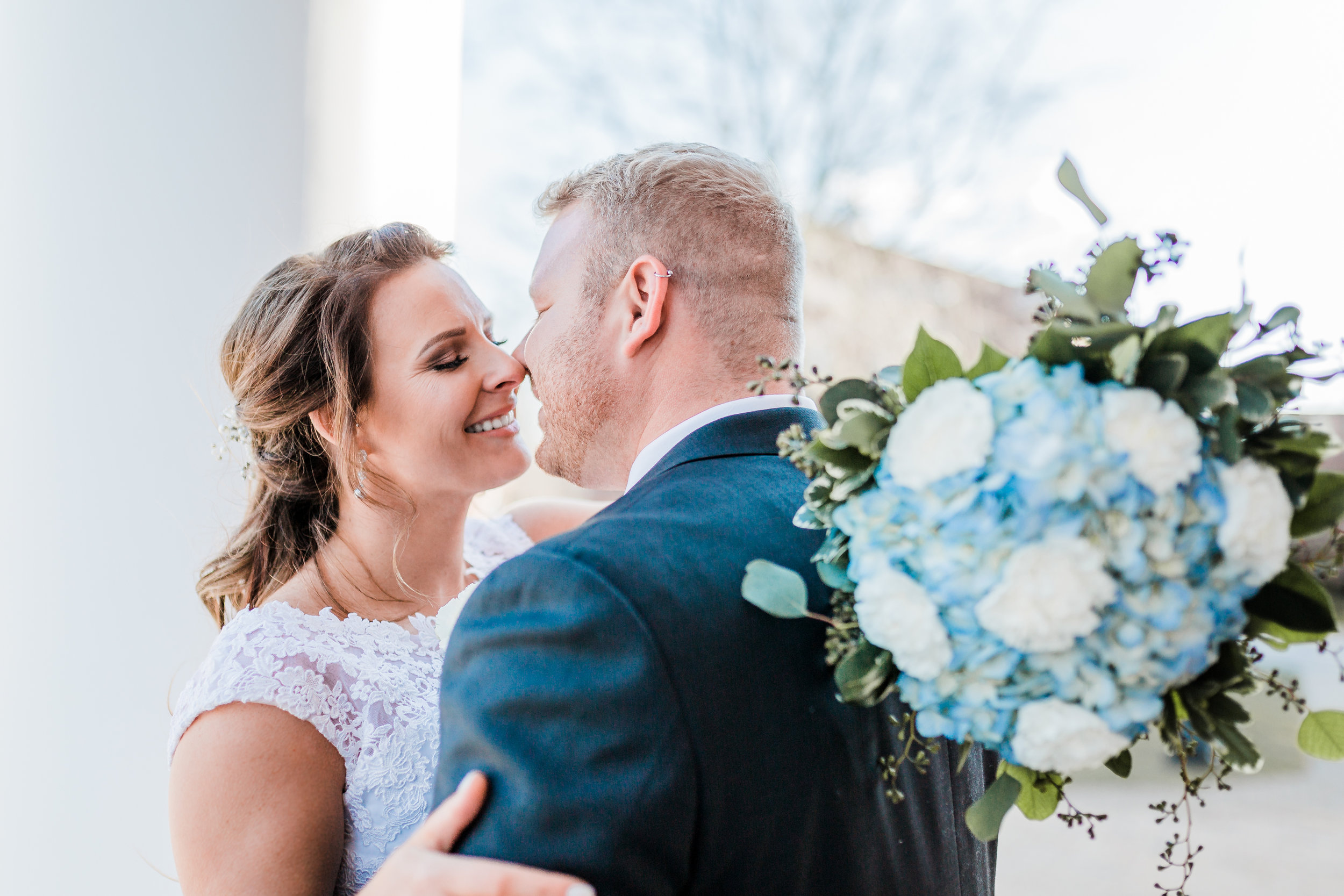 Maryland winter wedding with bride and groom about to kiss