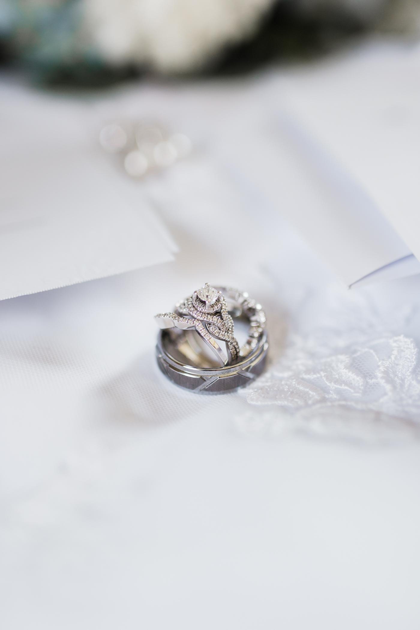 Bridal details of bride and groom wedding rings