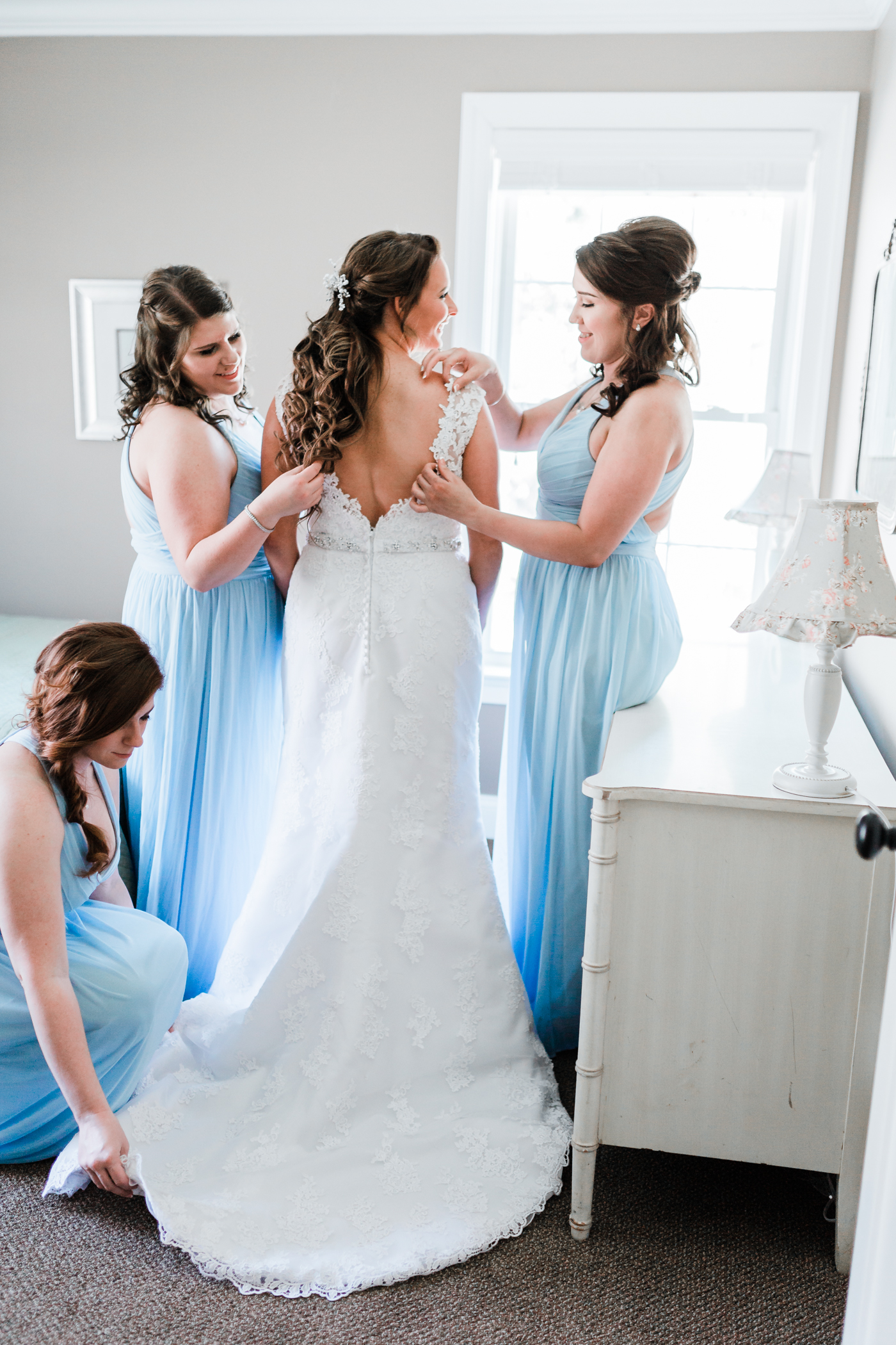 Bride and her bridesmaids getting ready for the wedding