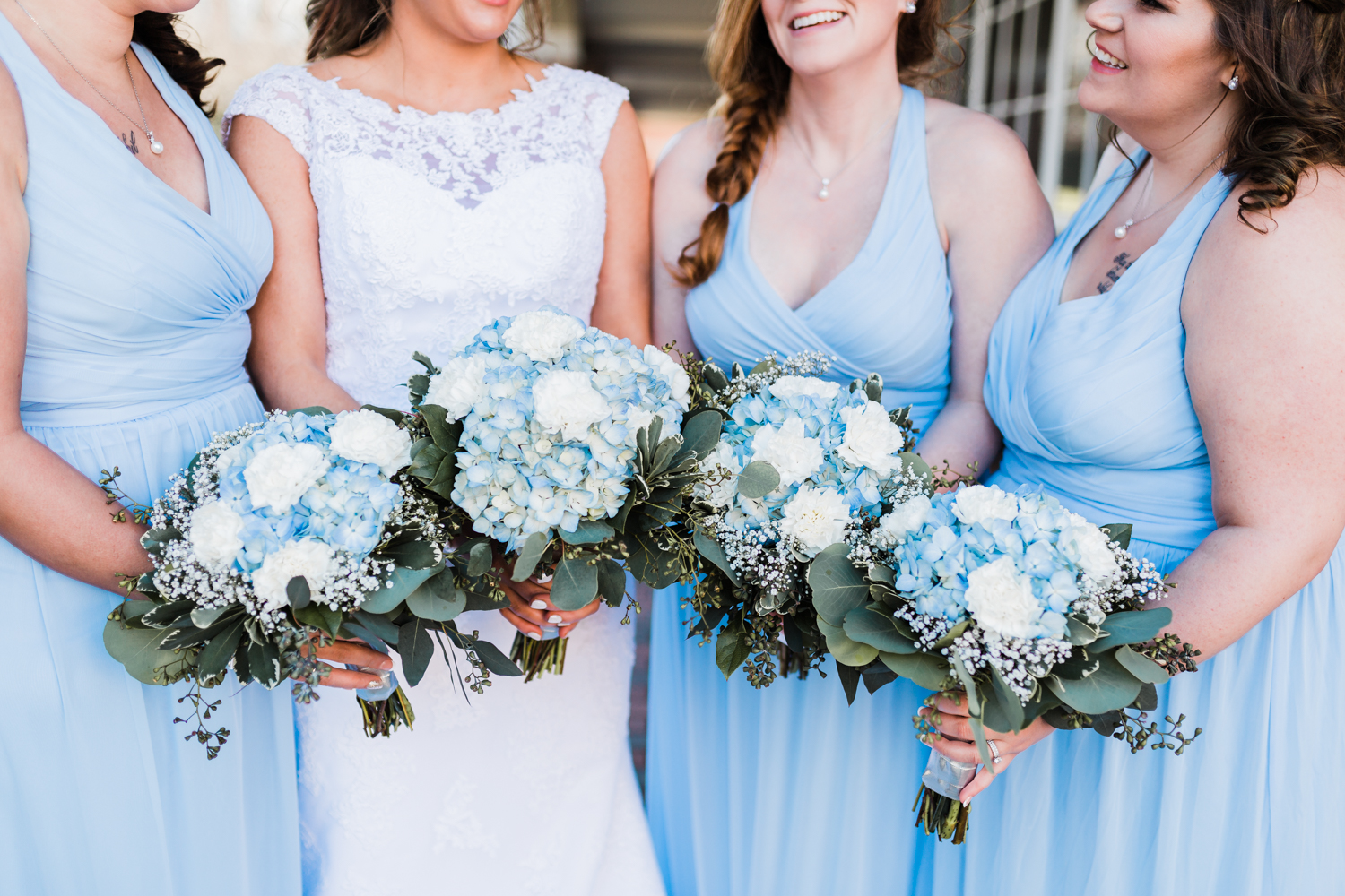 Wedding day details of bride and bridesmaids bouquets for icy blue Maryland wedding