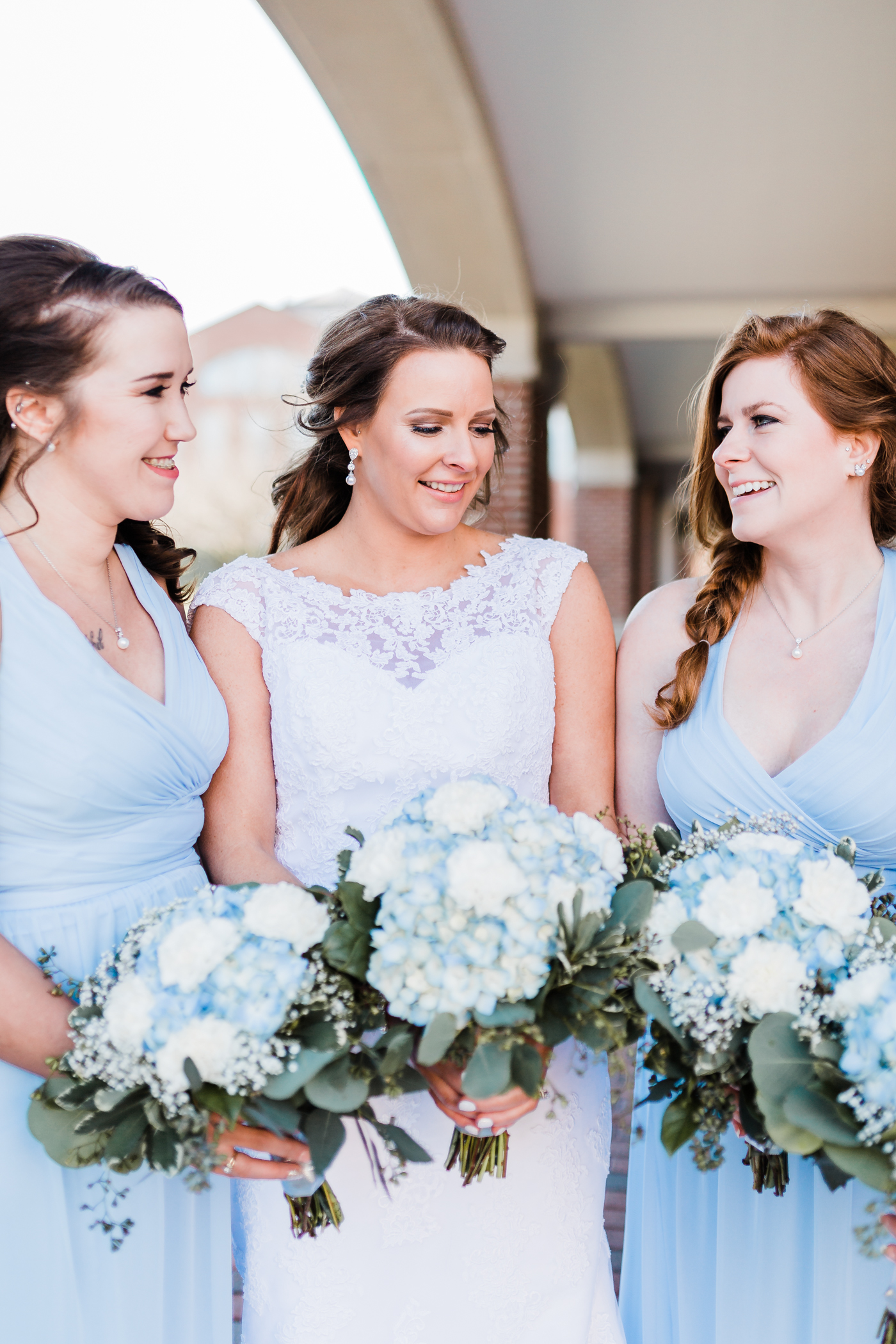 Stunning bride posing with her bridesmaids on her wedding day