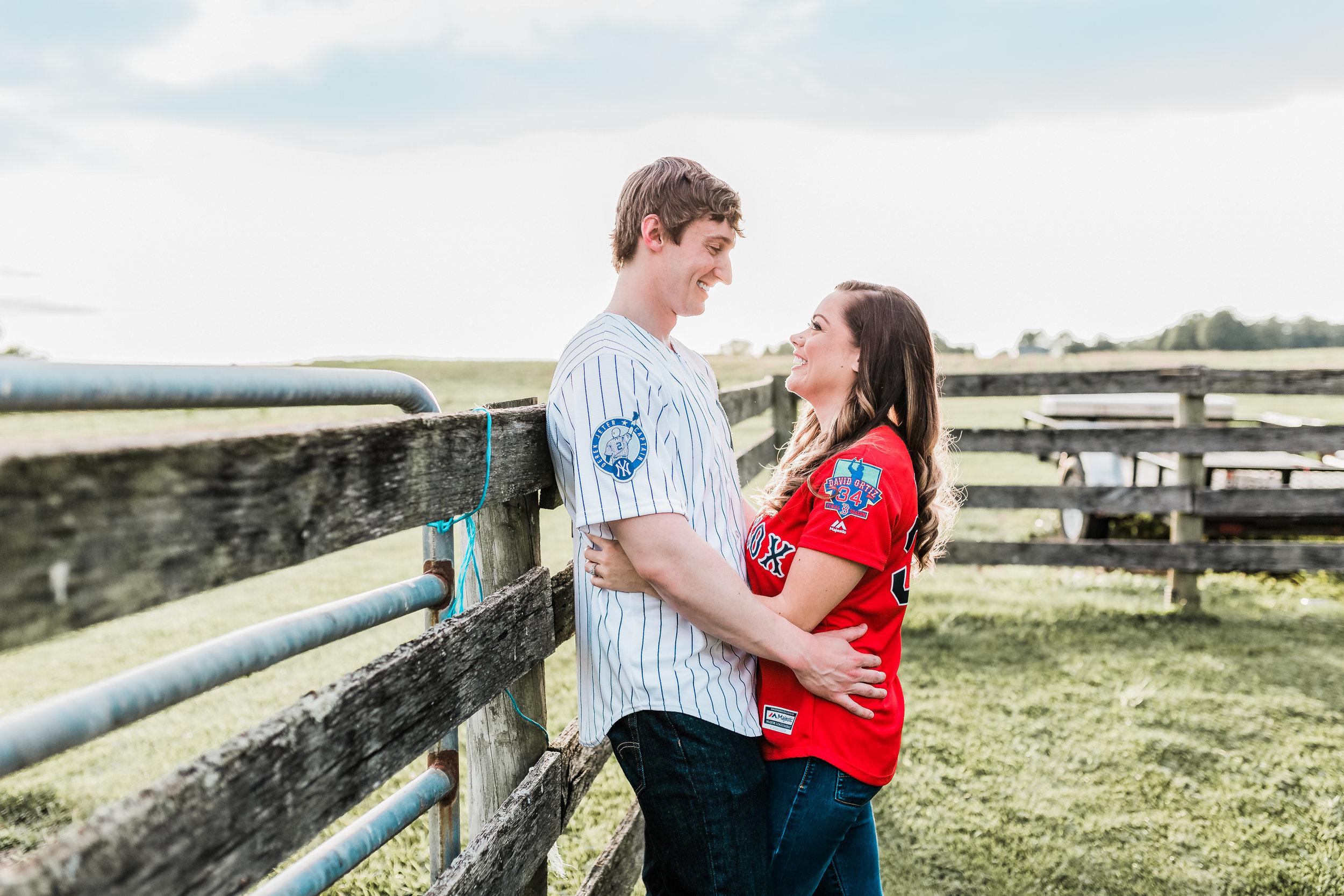 Engagement session couple smiling baseball jerseys