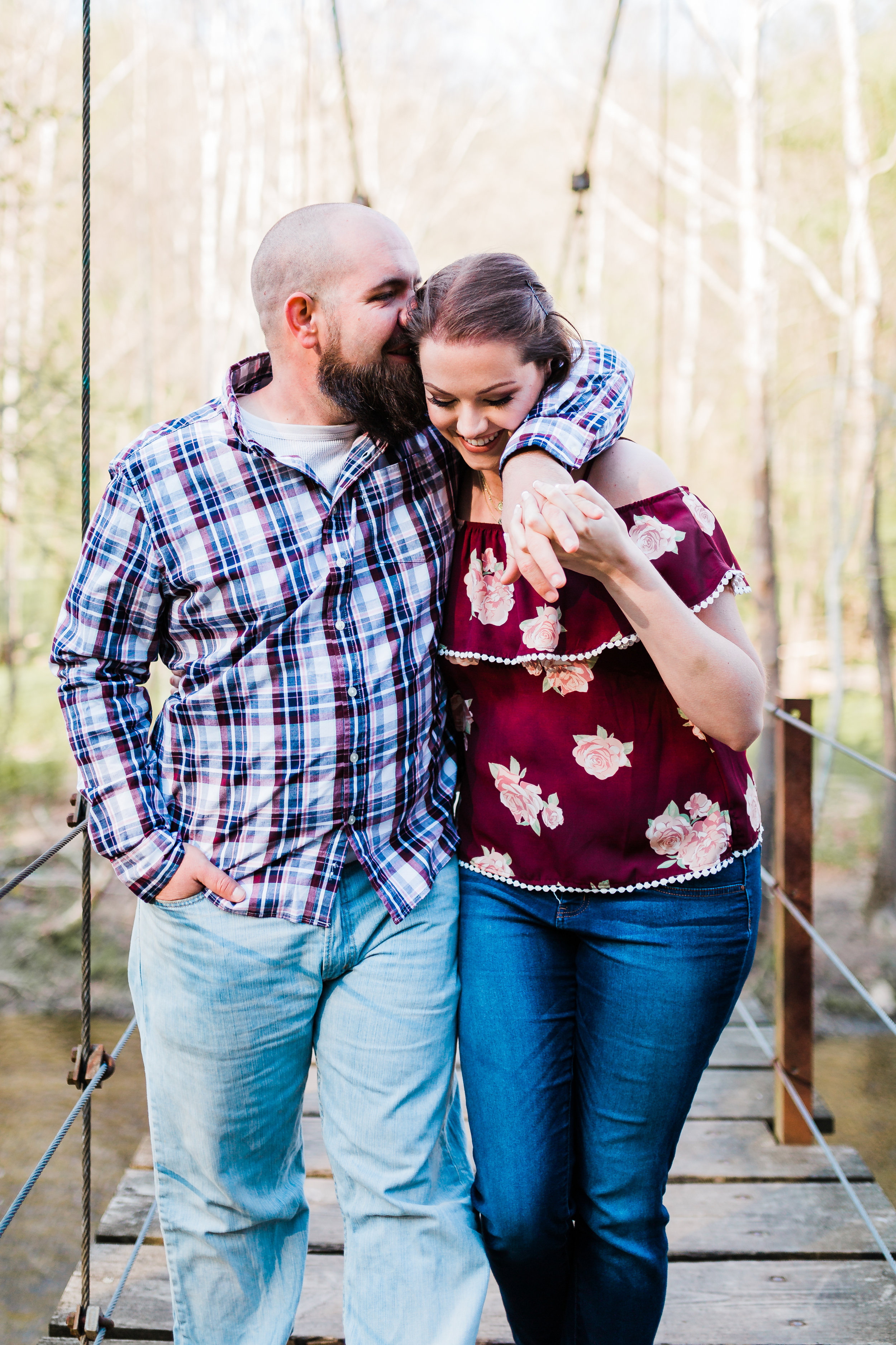 engagement session in maryland at patapsco valley walking and laughing couple
