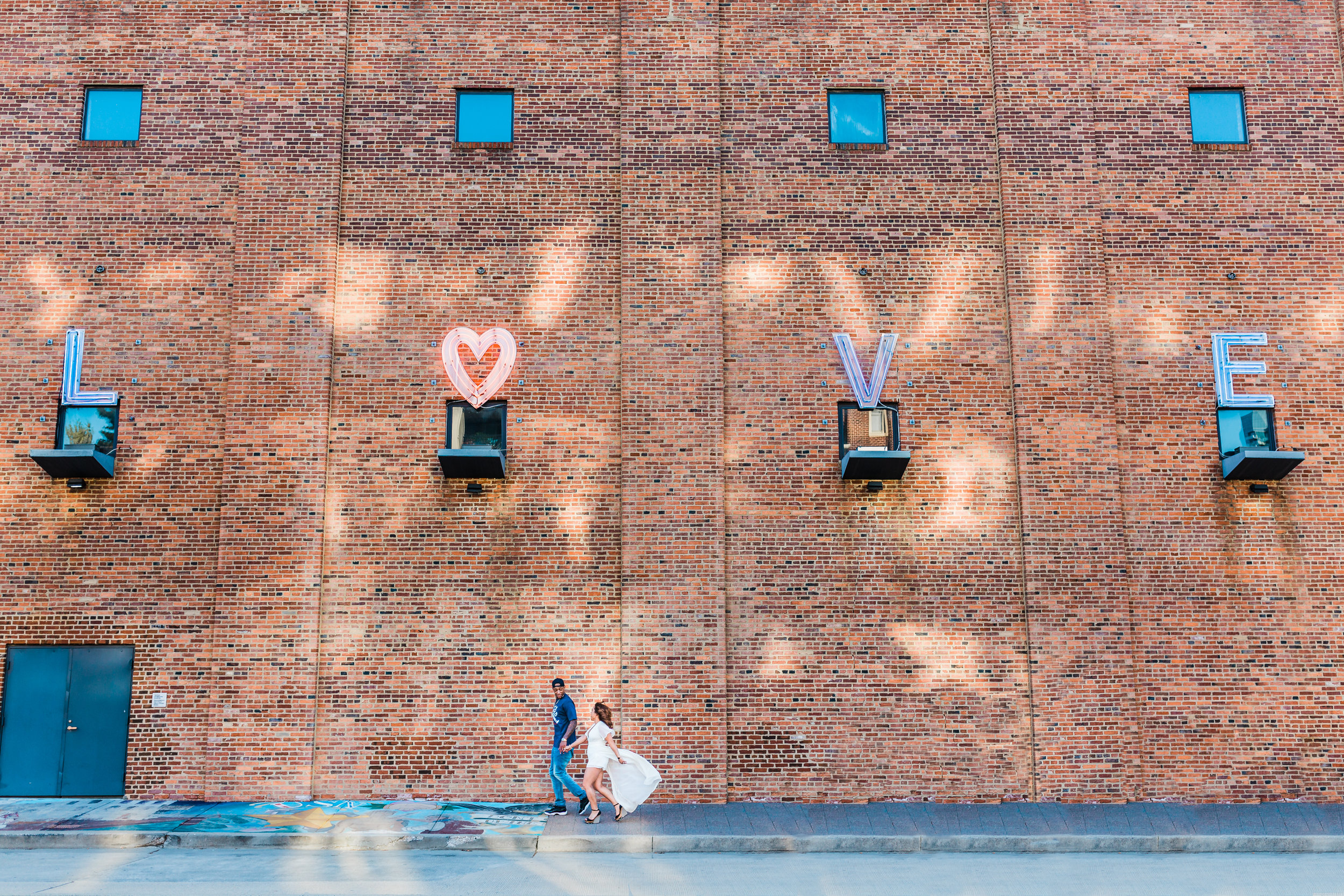 love sign in baltimore city during engagement session near federal hill