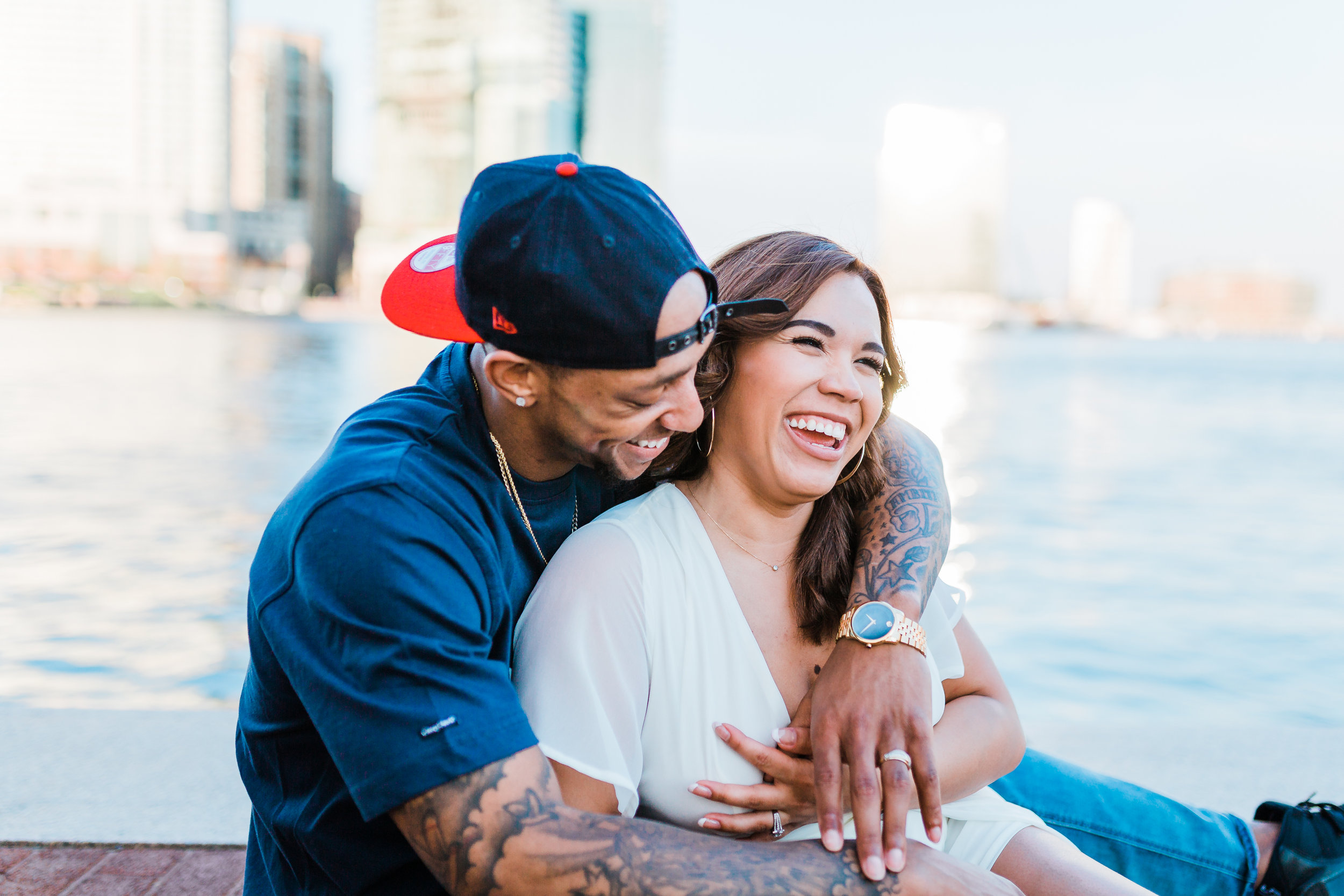 couple sitting and laughing together in baltimore maryland