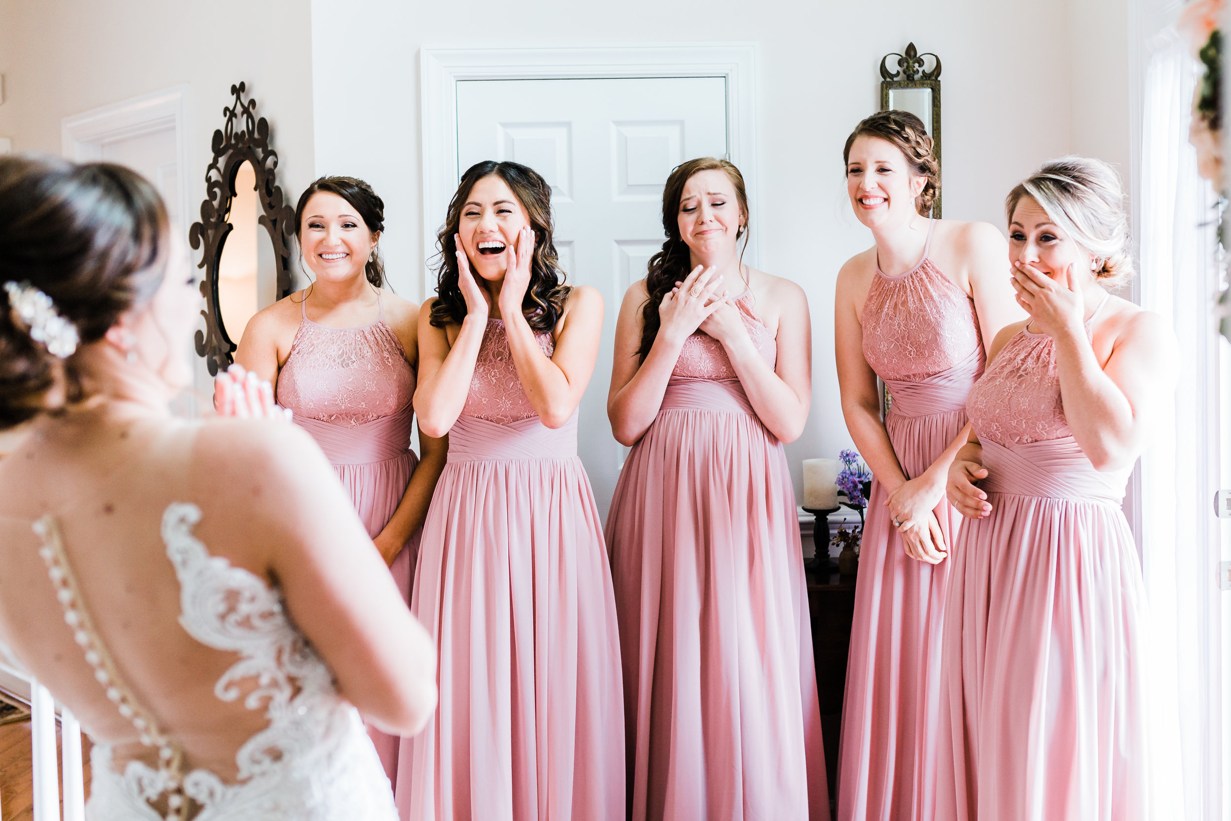 bridesmaids in awe over bride on her wedding day - md wedding photographer