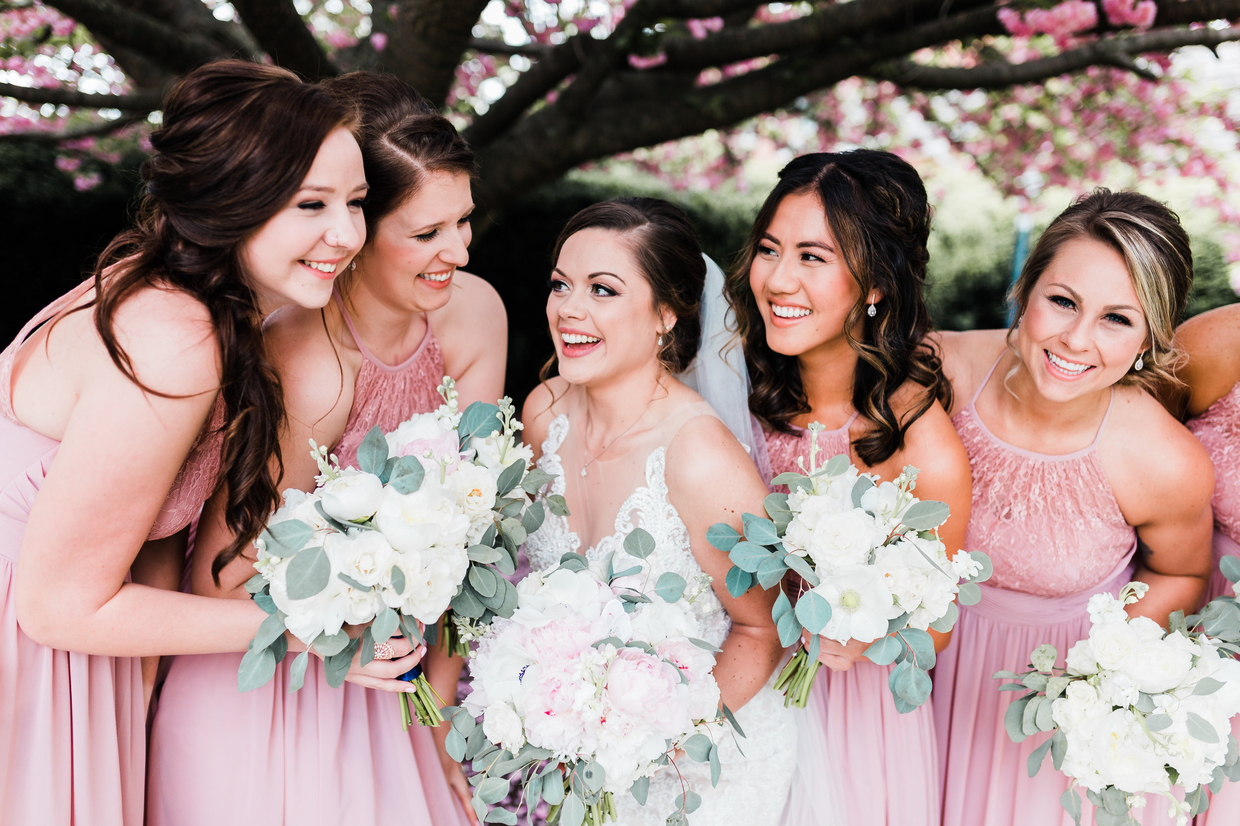 bride laughing with her bridesmaids in maryland wedding