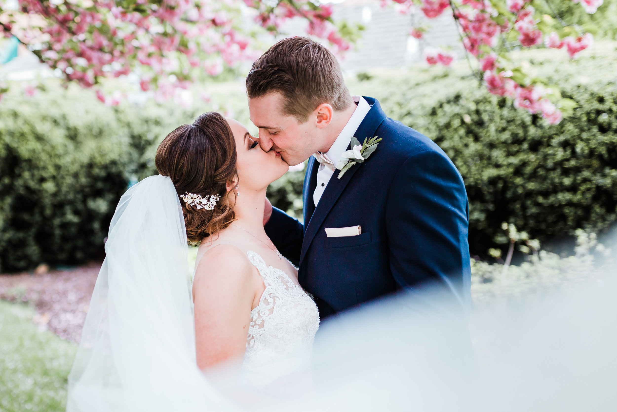 bride and groom kissing behind veil - maryland photographer