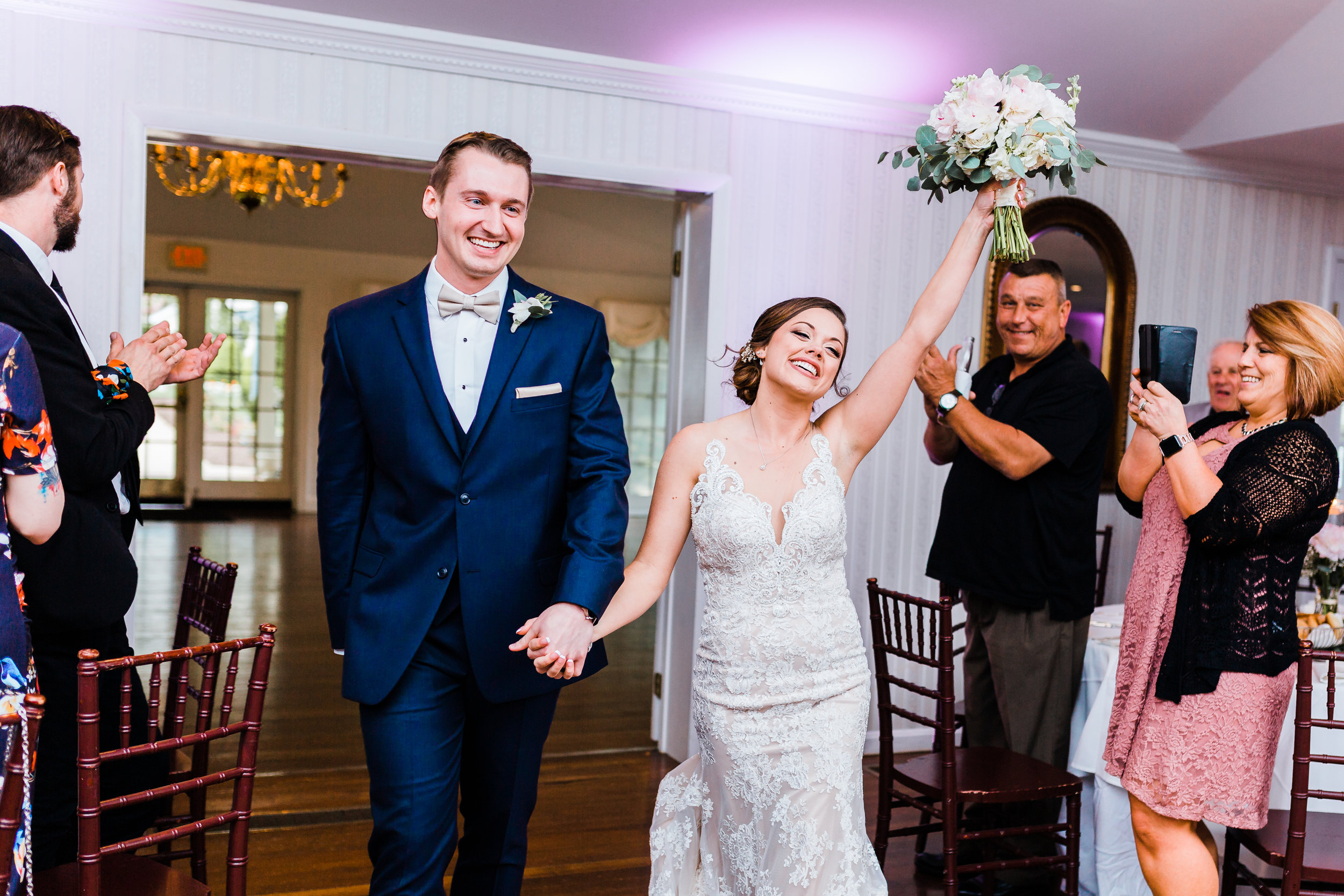 bride and groom coming in to their reception maryland wedding photographer