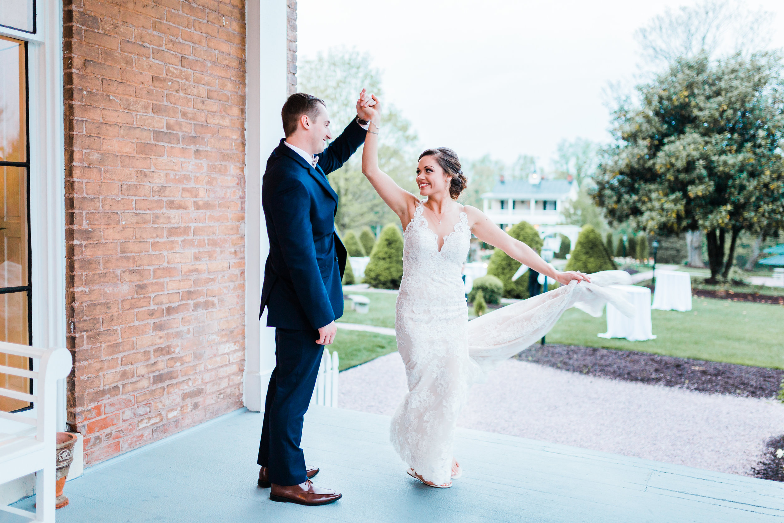 bride and groom dancing on the deck at antrim 1844 in taneytown md - photographer