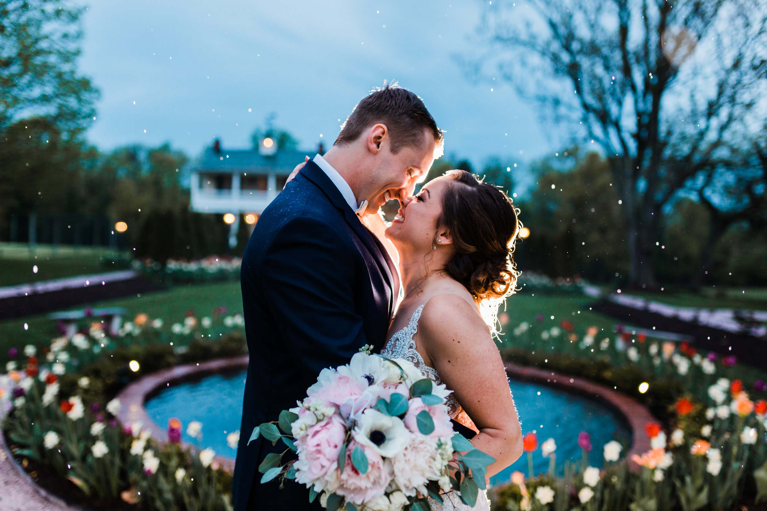 bride and groom laughing in the rain at md wedding - photography