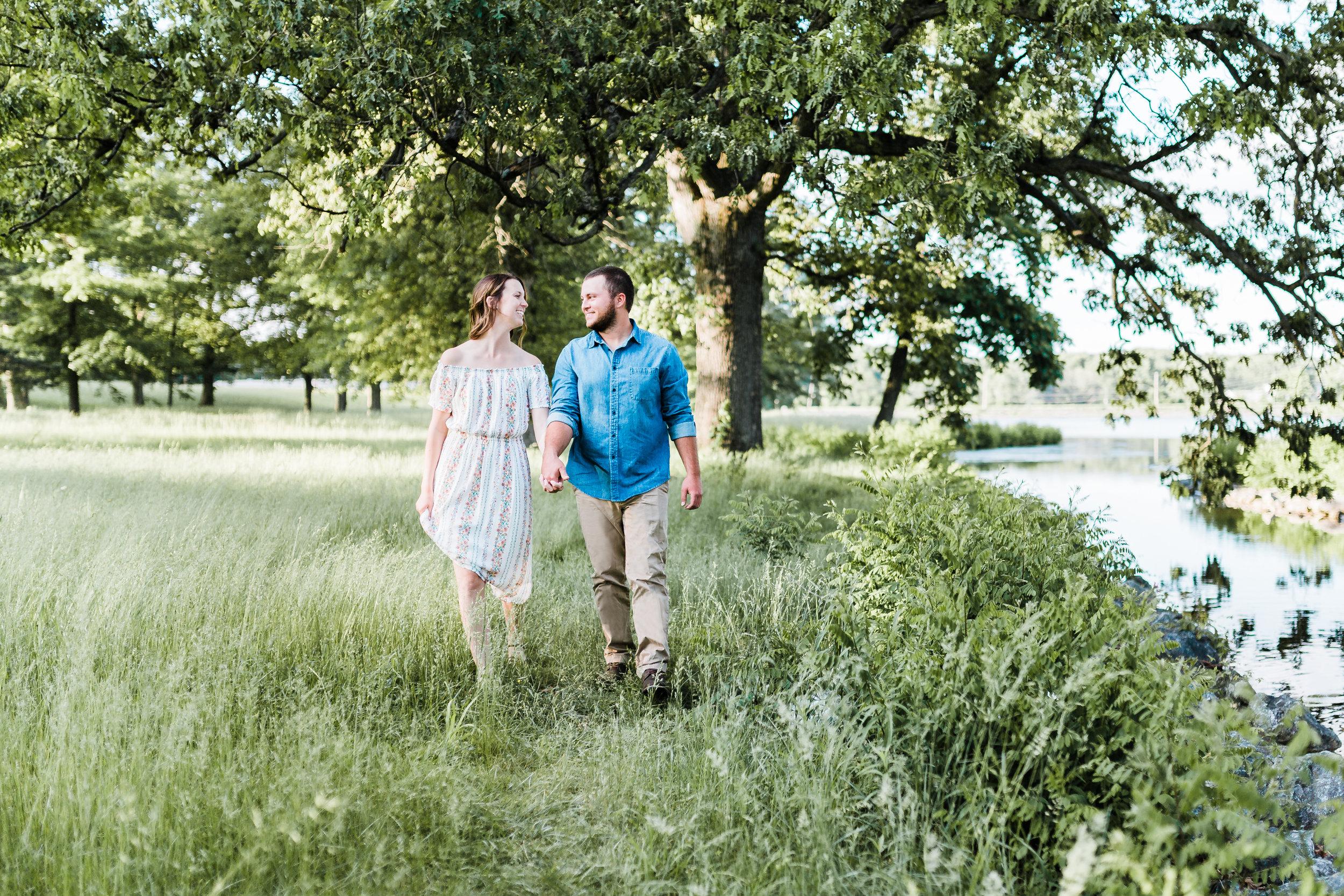 maryland engagement photographer - couple holding hands and walking