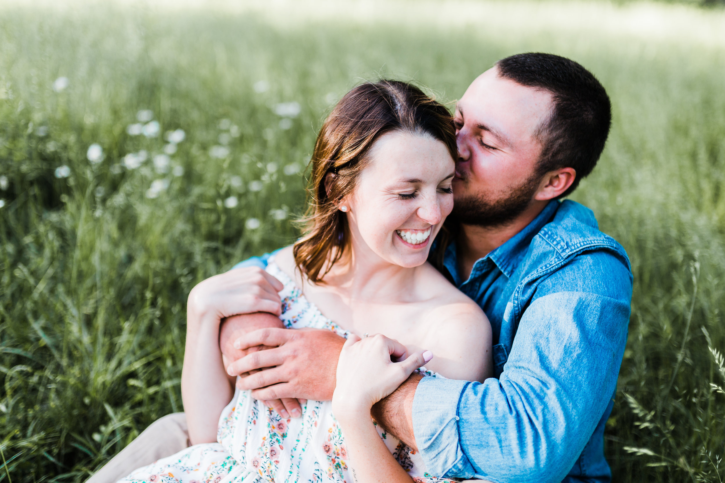 groom hugging his bride at maryland engagement session - md engagement photographer