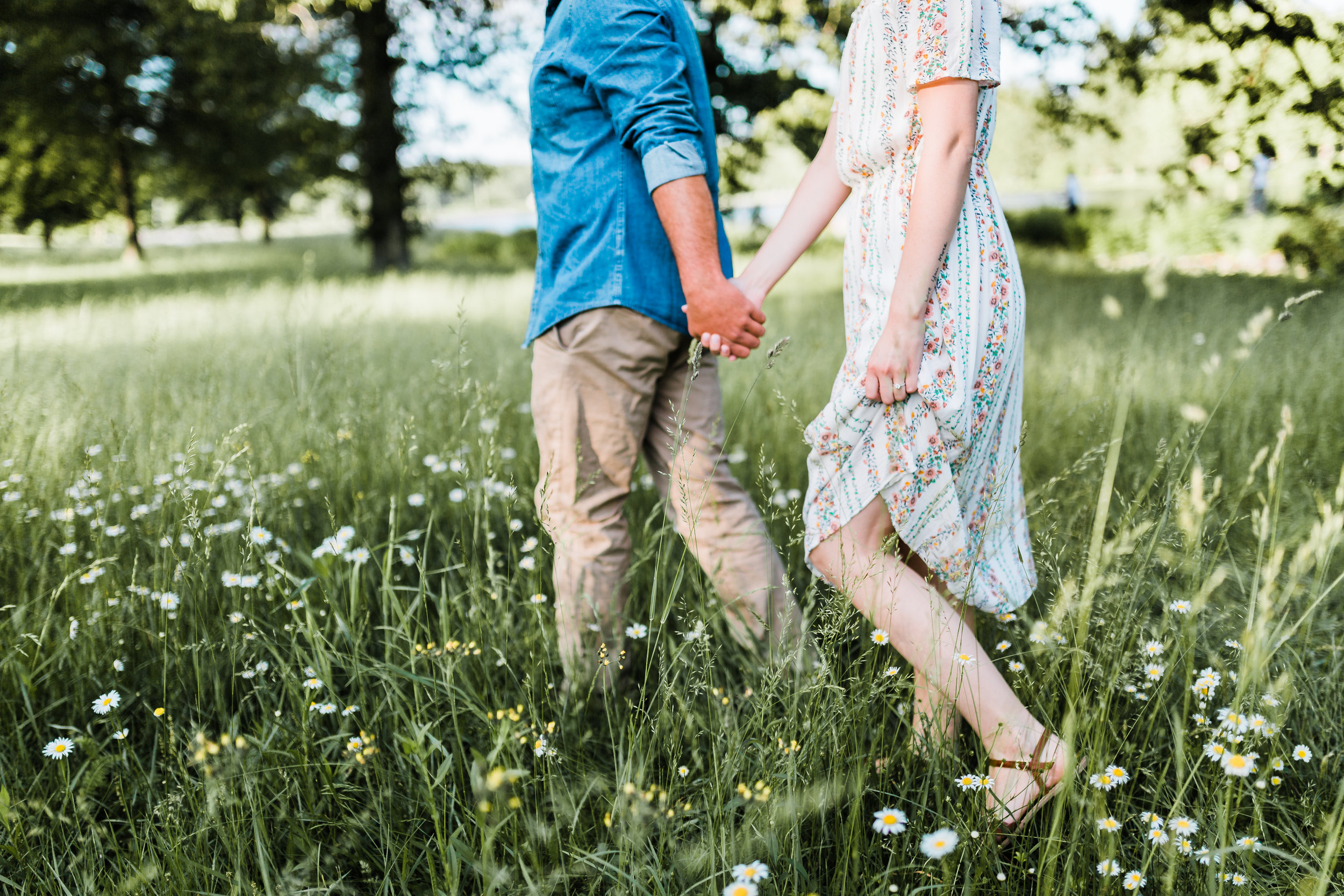 couple walking and holding hands - romantic maryland engagement session