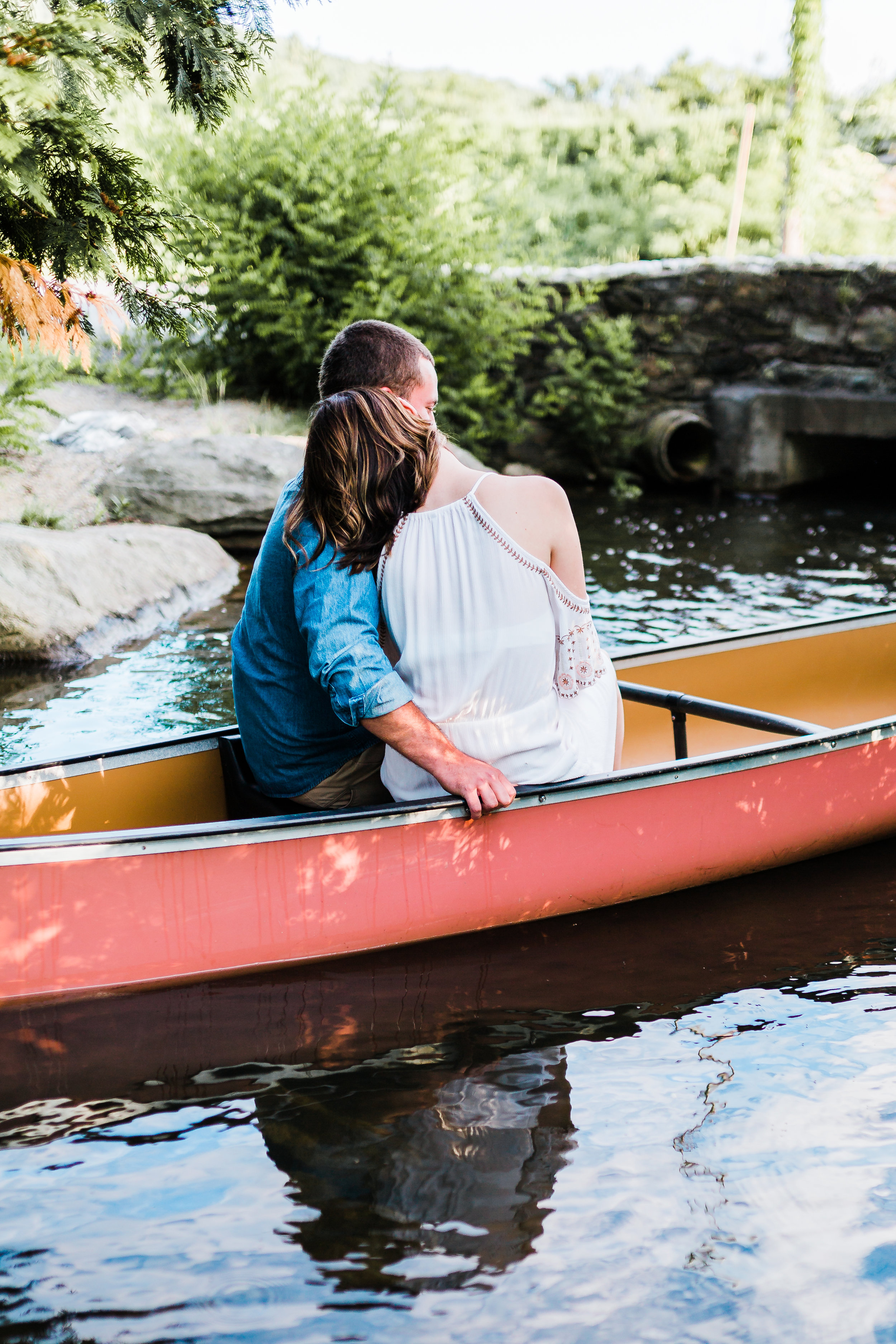romantic canoe engagement session in cascade maryland
