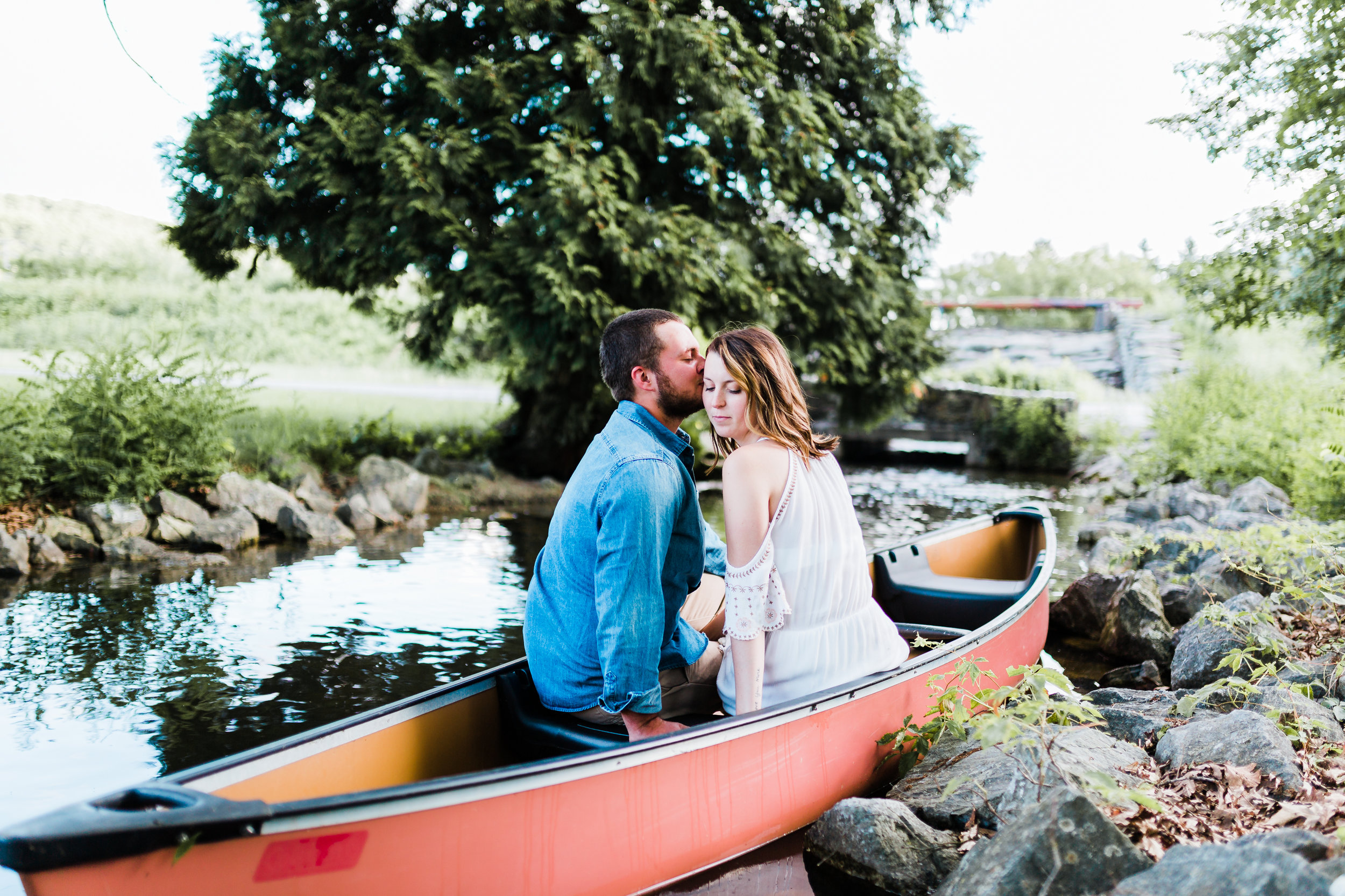 kissing in the canoe during maryland engagement session