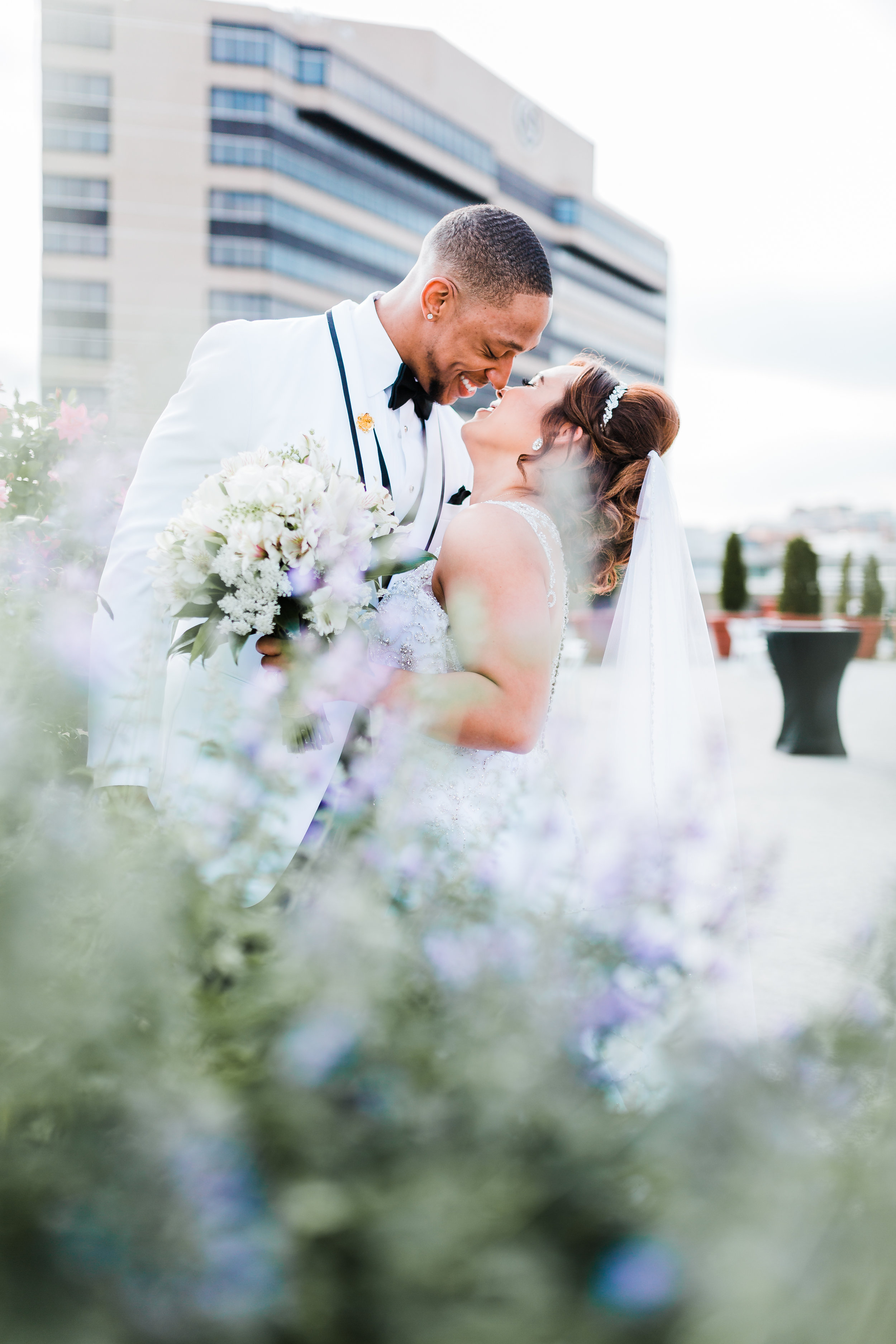 baltimore couple laughing together at Hyatt Regency - md wedding photographer