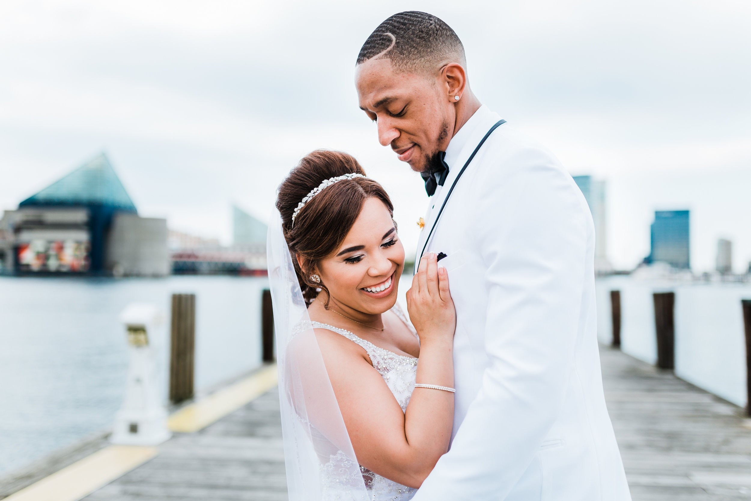 bride and groom share last photo before reception - baltimore wedding photographer and cinematographer