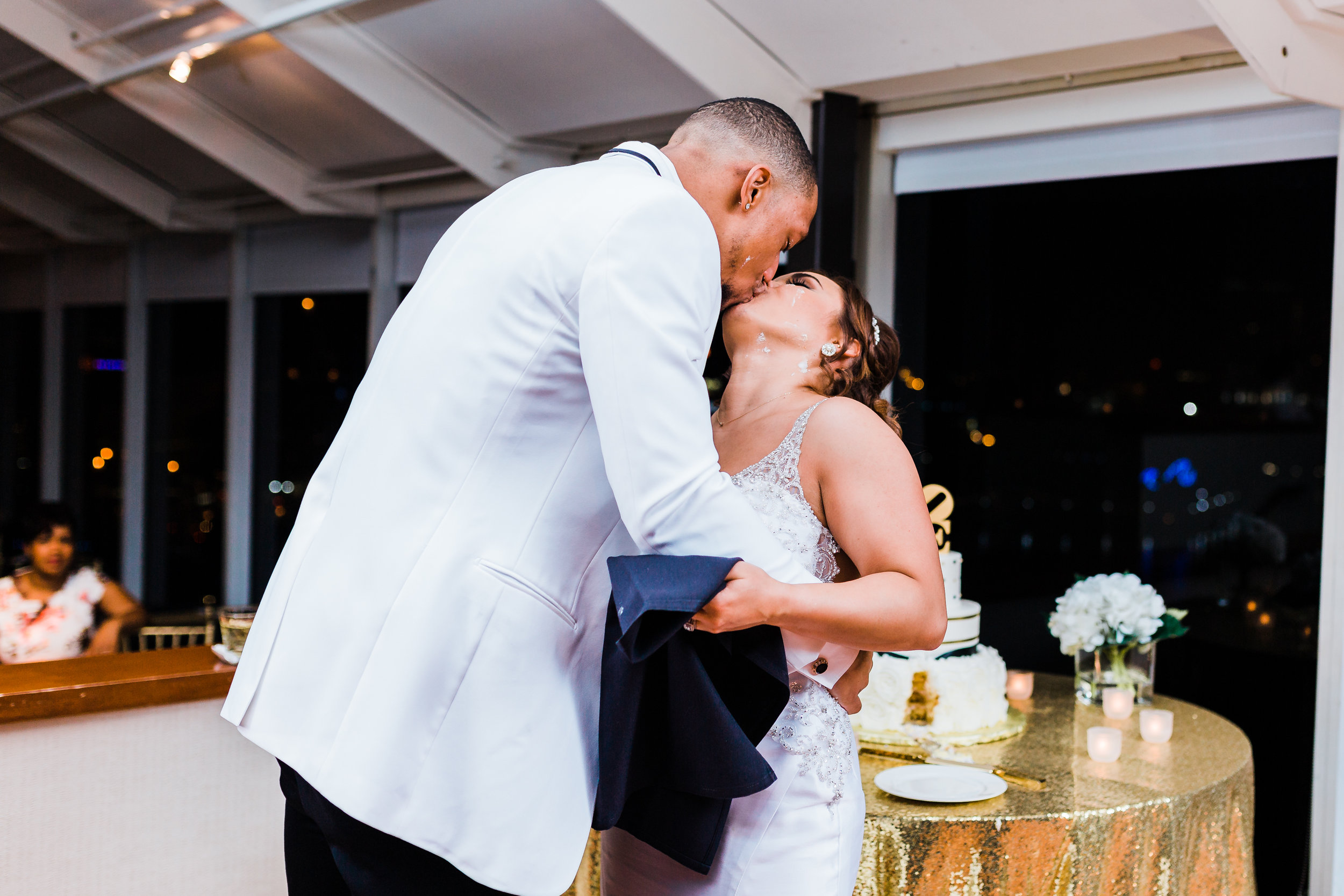 bride and groom kiss after cake cutting at baltimore maryland wedding