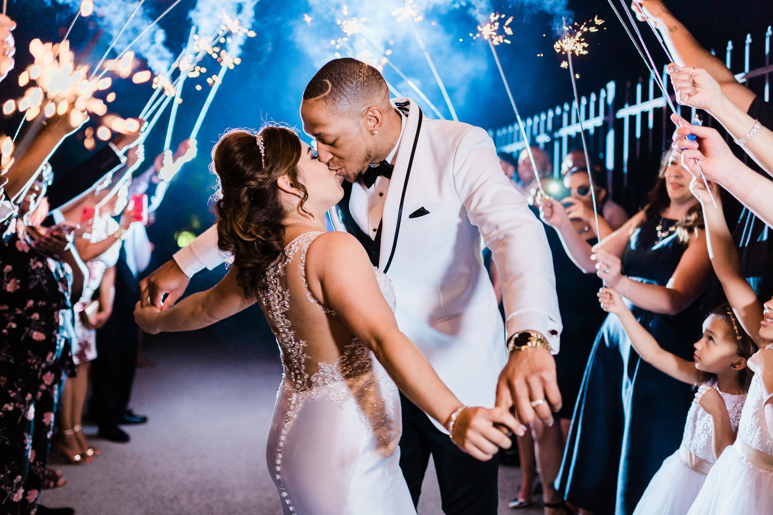 bride and groom kiss during grand exit - sparkler exit - maryland wedding photographer and cinematographer