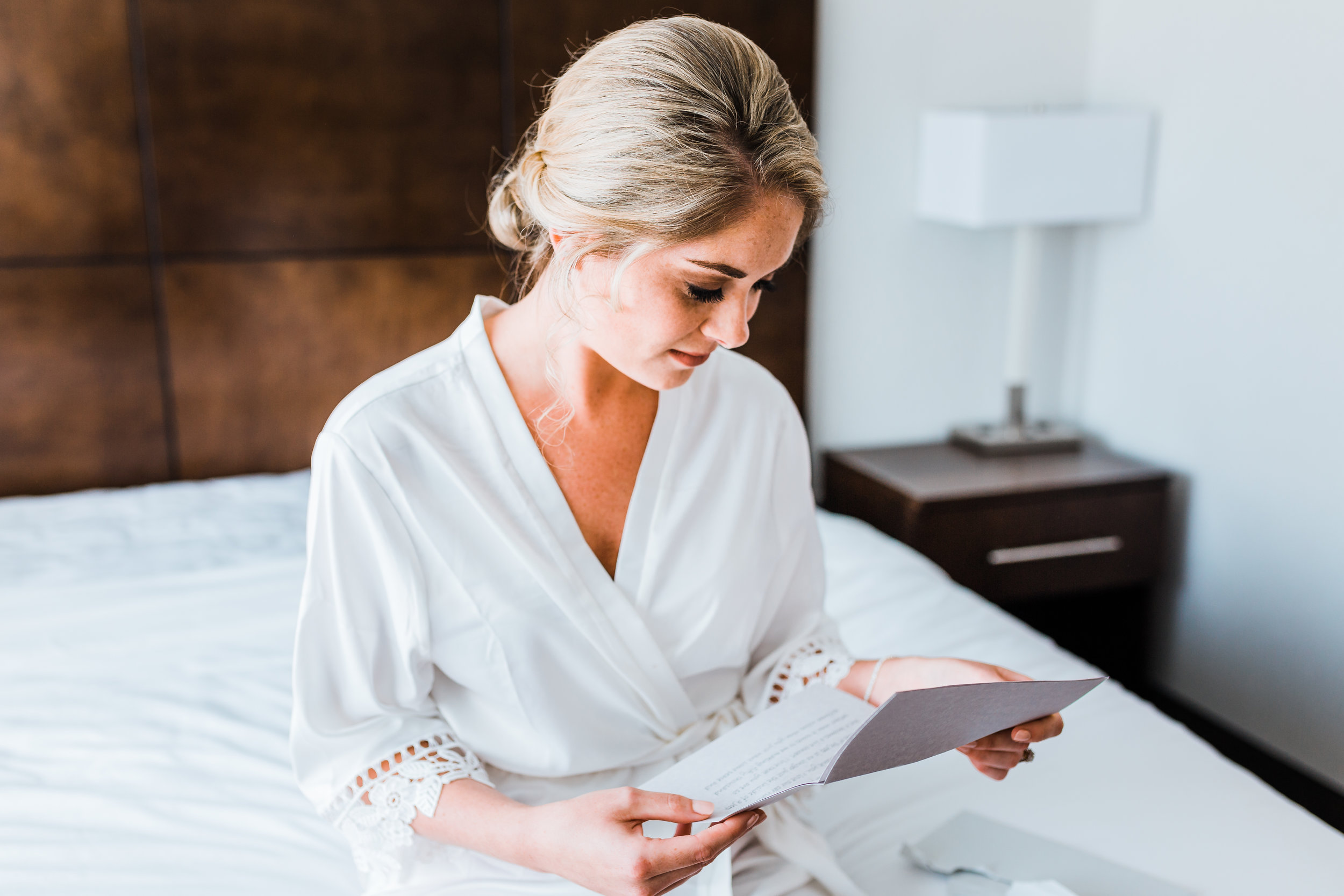 bride gets emotional as she reads her letter from her groom on their wedding day in pasadena maryland