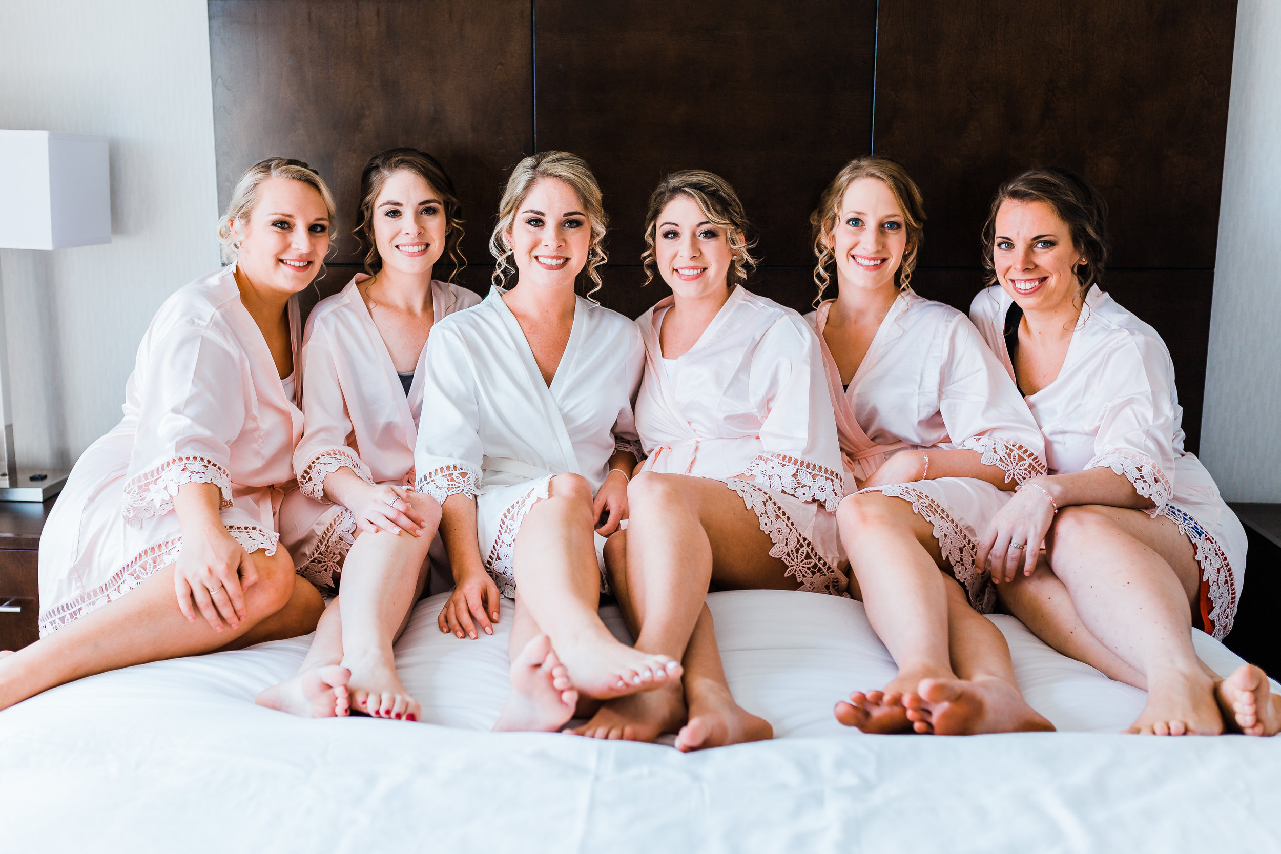 bride and her bridesmaids in matching lace robes getting ready - maryland wedding photographer