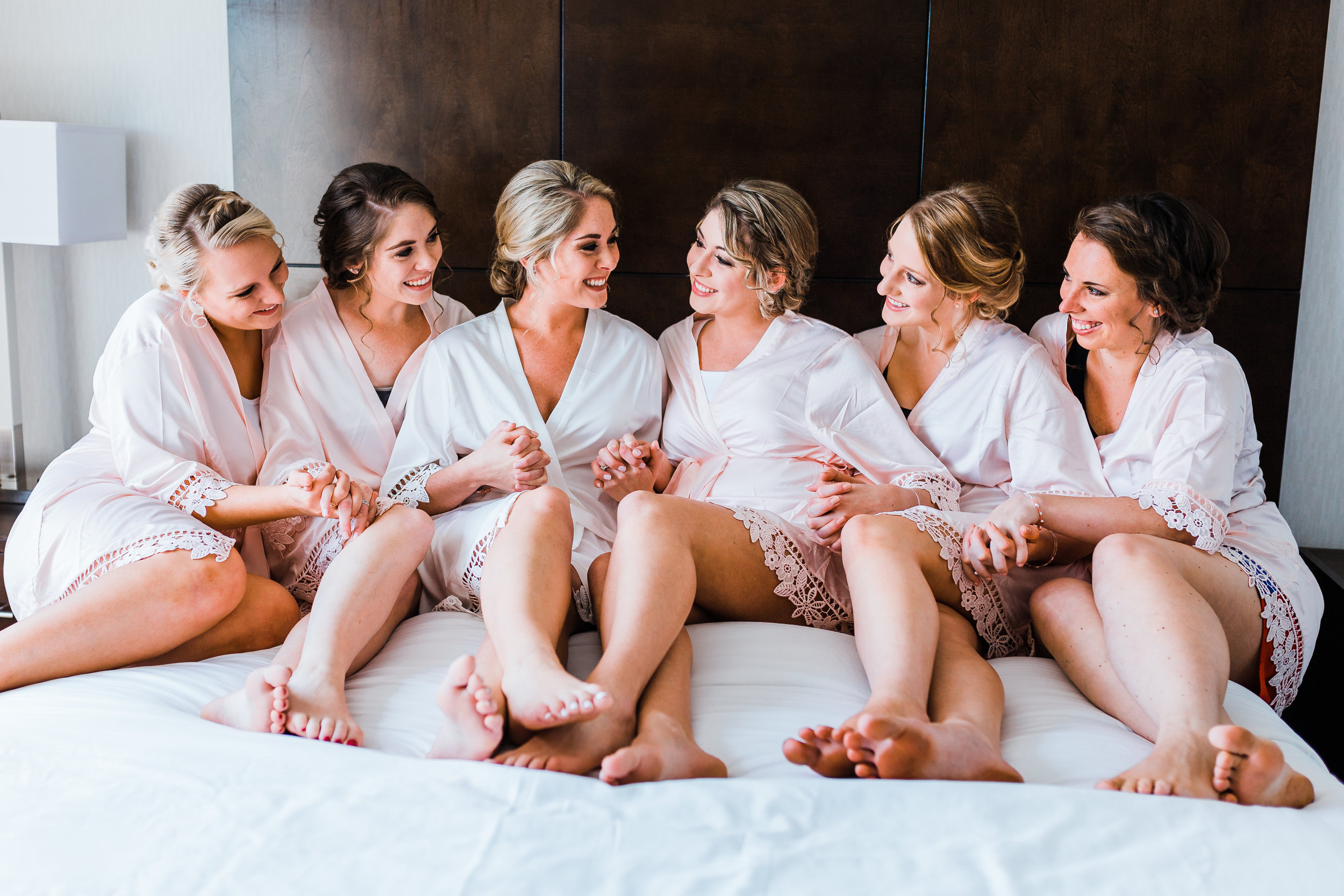 bride laughing with her bridesmaids getting ready for pasadena maryland wedding
