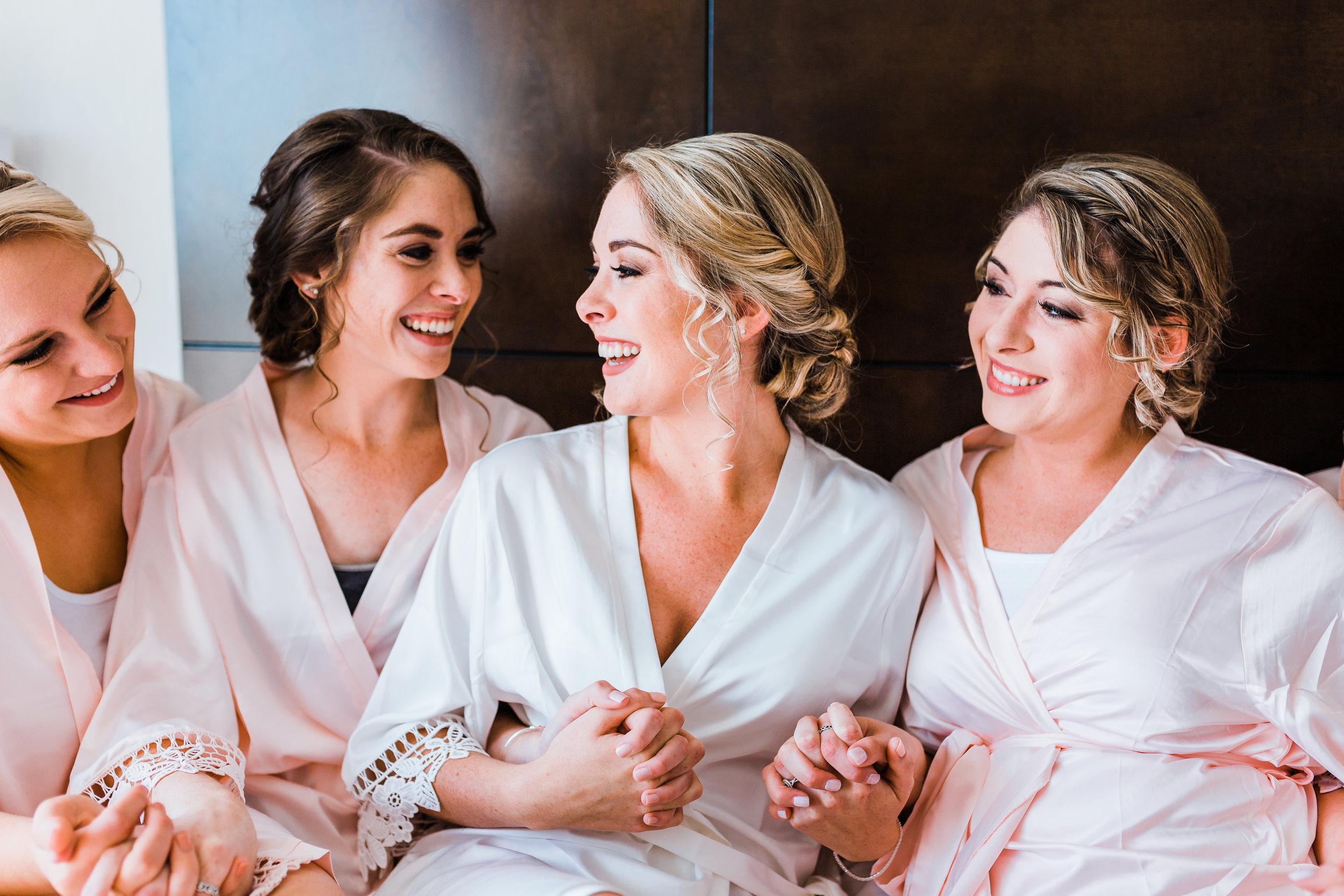 beautiful bride laughing with bridesmaids in pasadena md