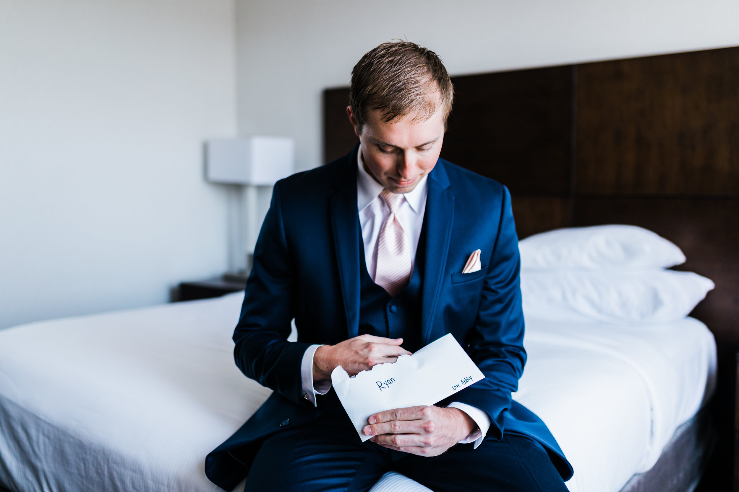 groom reading his letter from his bride - celebrations at the bay maryland wedding photographer