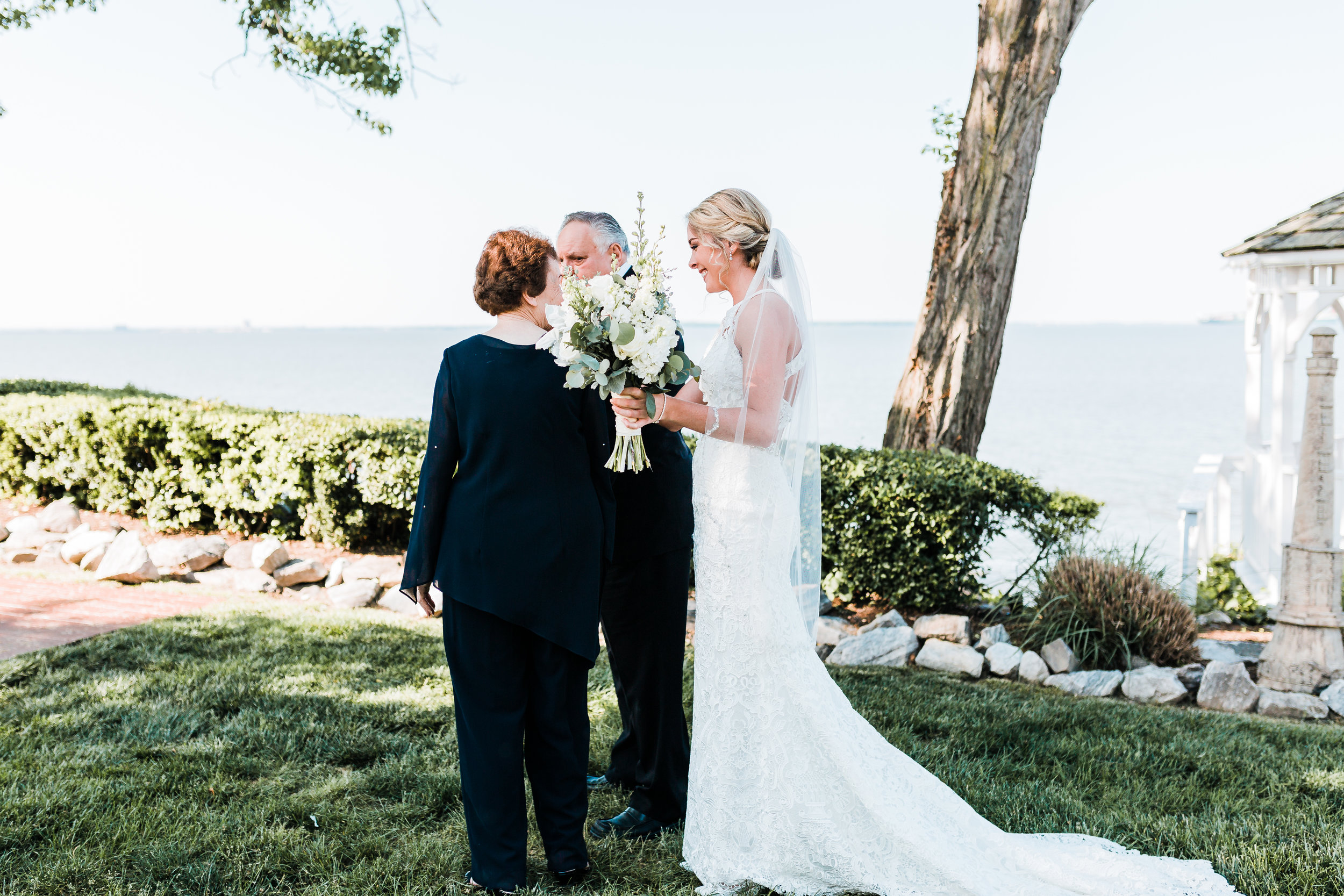 bride shares a first look with her grandparents at celebrations at the bay in pasadena md